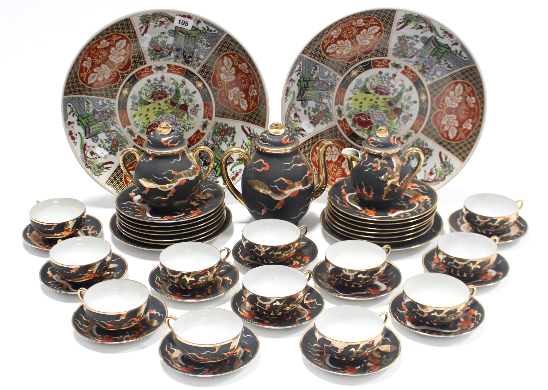 Lot 161 - A Japanese porcelain forty-one piece tea & coffee service (settings for twelve), of black ground &