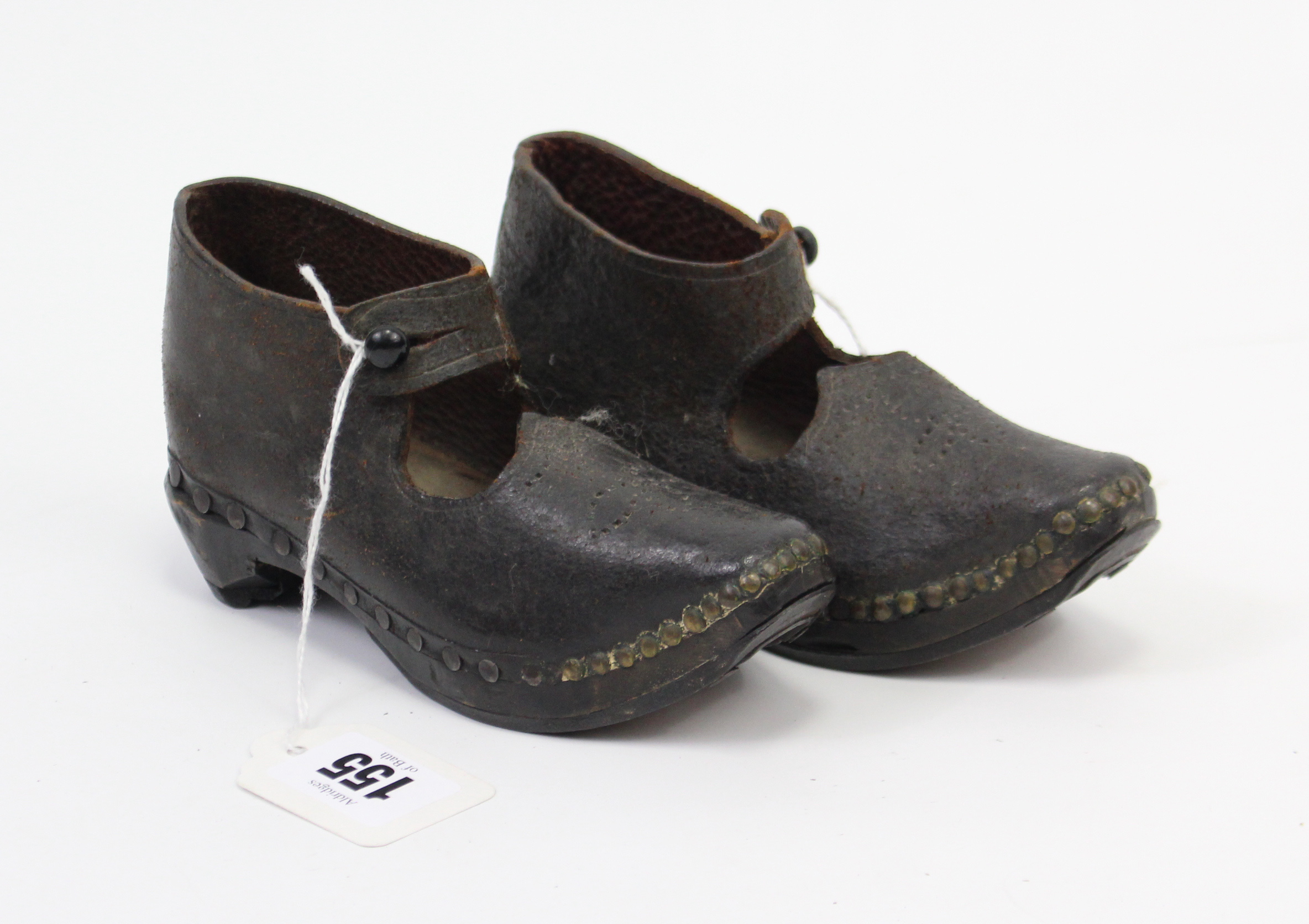 Lot 155 - A pair of children's clogs.