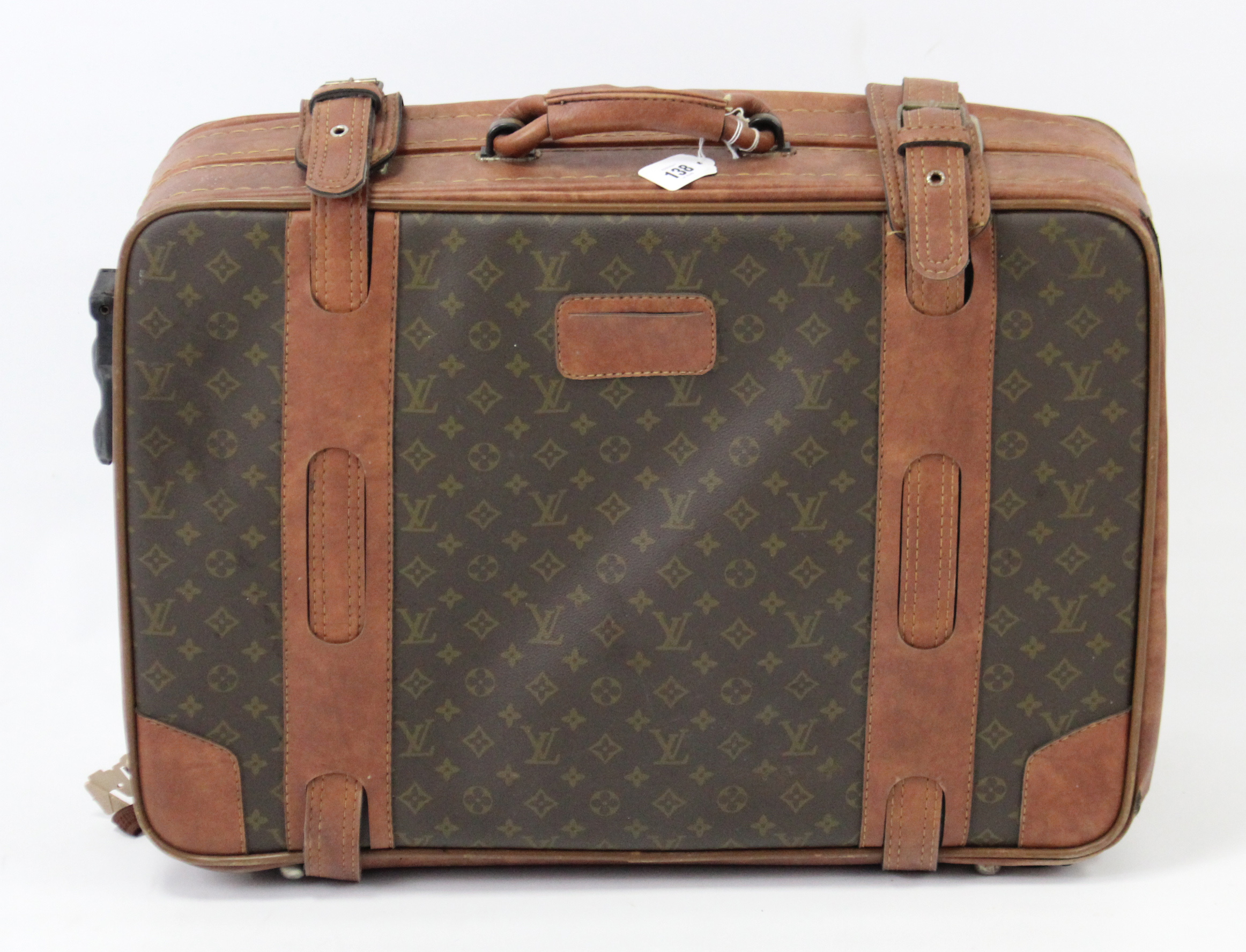 """Lot 138 - A Louis Vuitton (?) suitcase, fitted chrome twin-lever locks, 25"""" wide."""