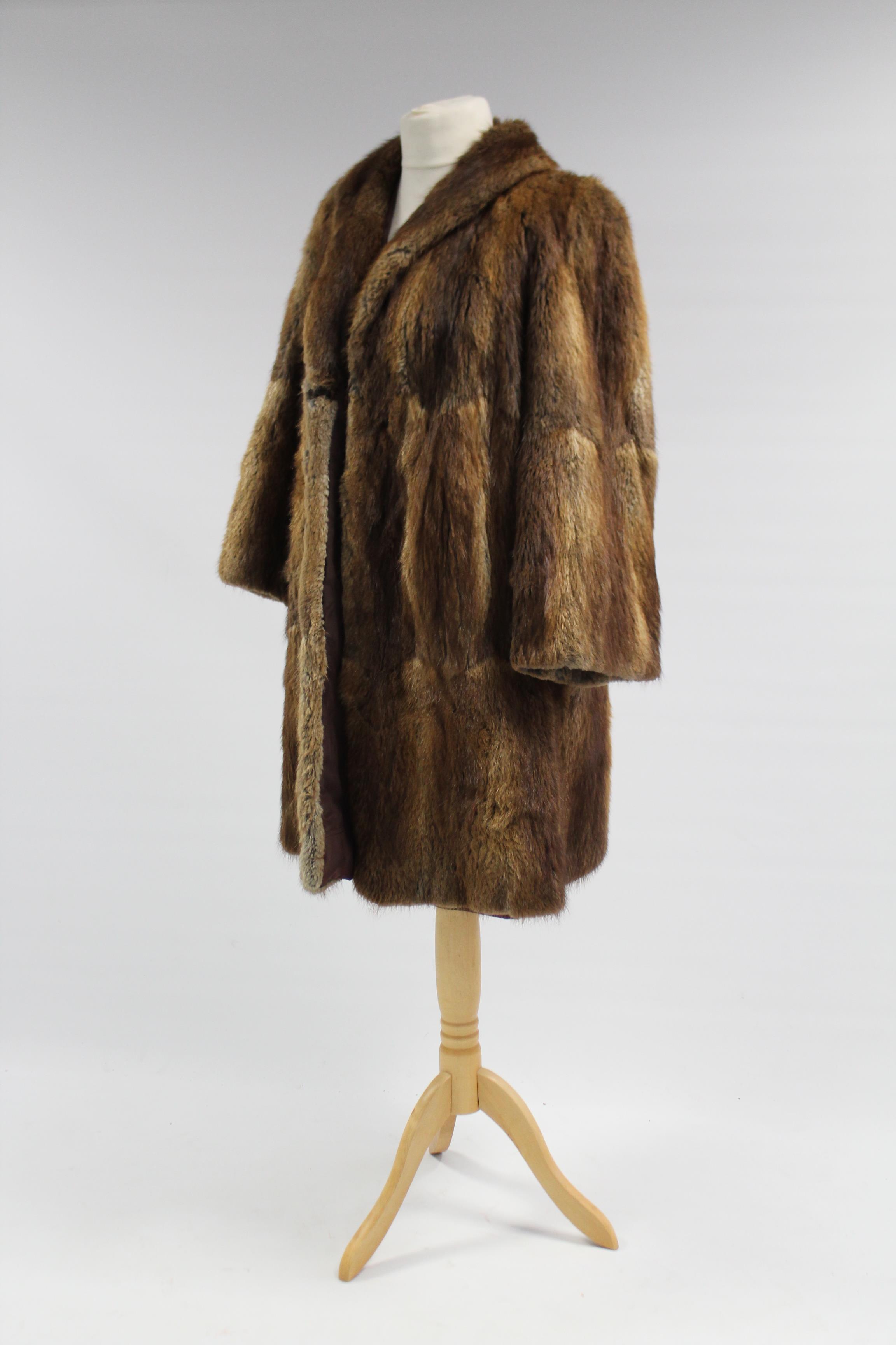 Lot 150 - A rabbit fur silk-lined ladies' coat; & a similar silk-lined fur cape.