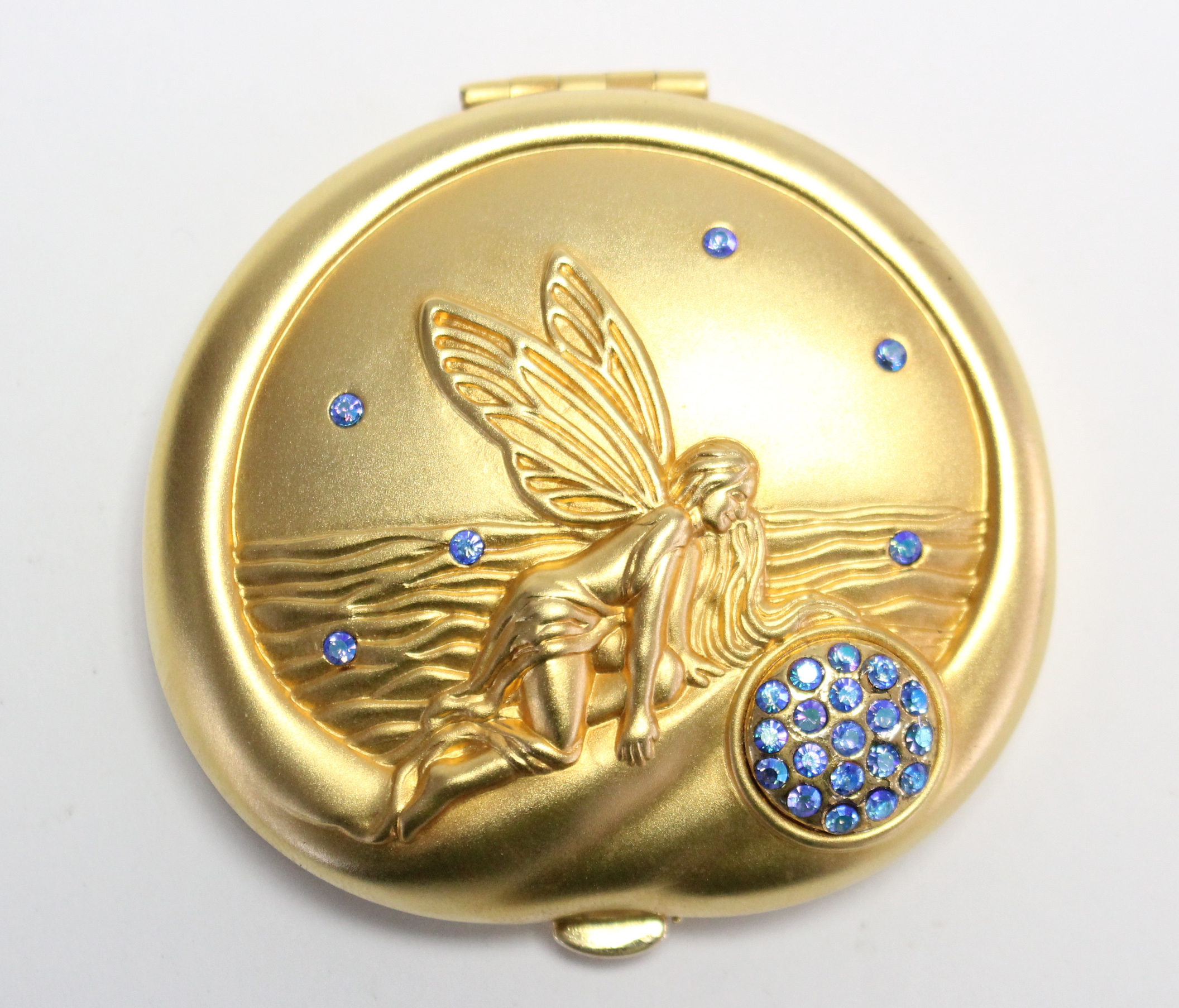 "Lot 178 - An Estee Lauder Pisces ""Lucidity"" gilt-metal compact, with pouch."