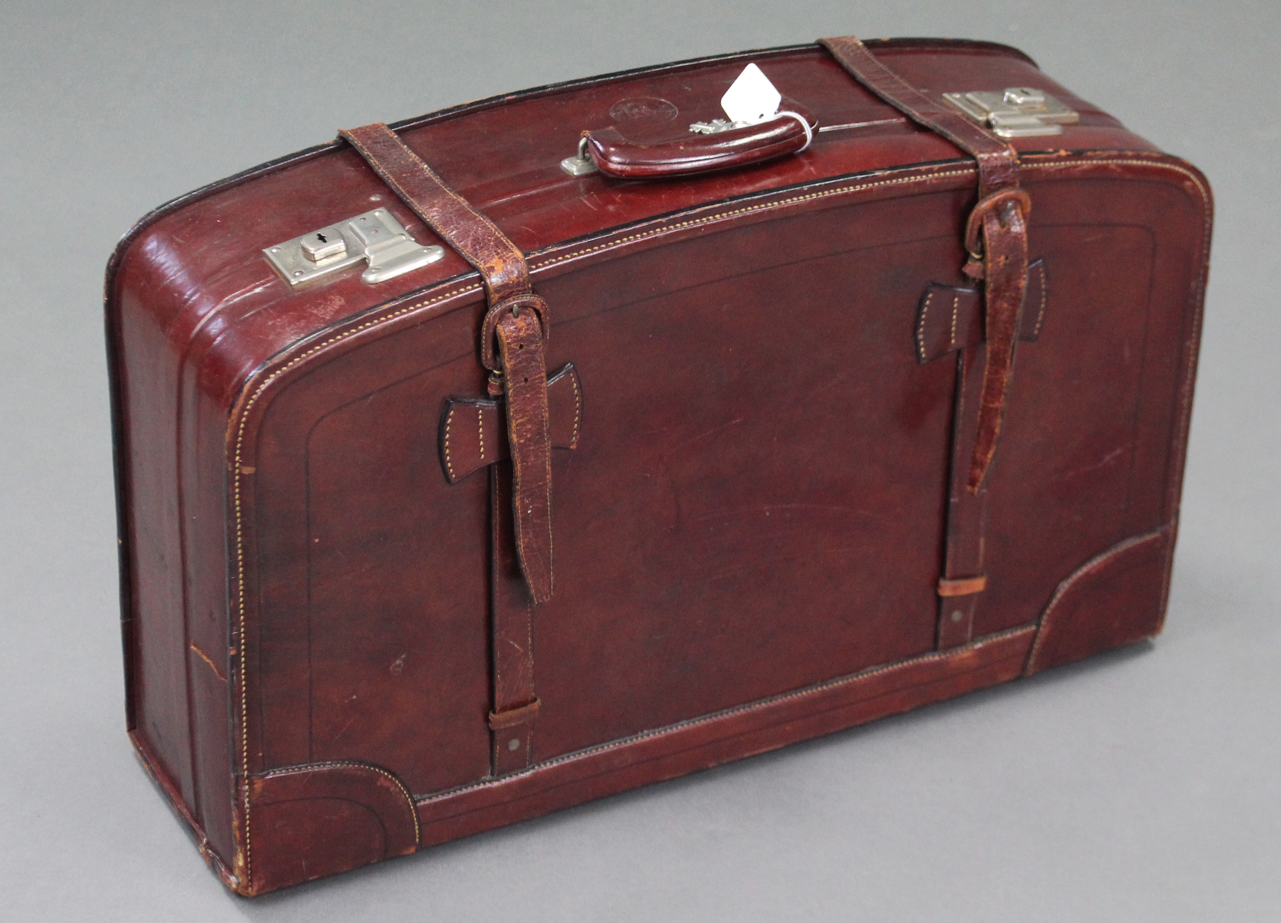"""Lot 14 - A Chinese """"Rhinoceros"""" brand brown leather large suitcase by the Fook Seng Company; together with"""