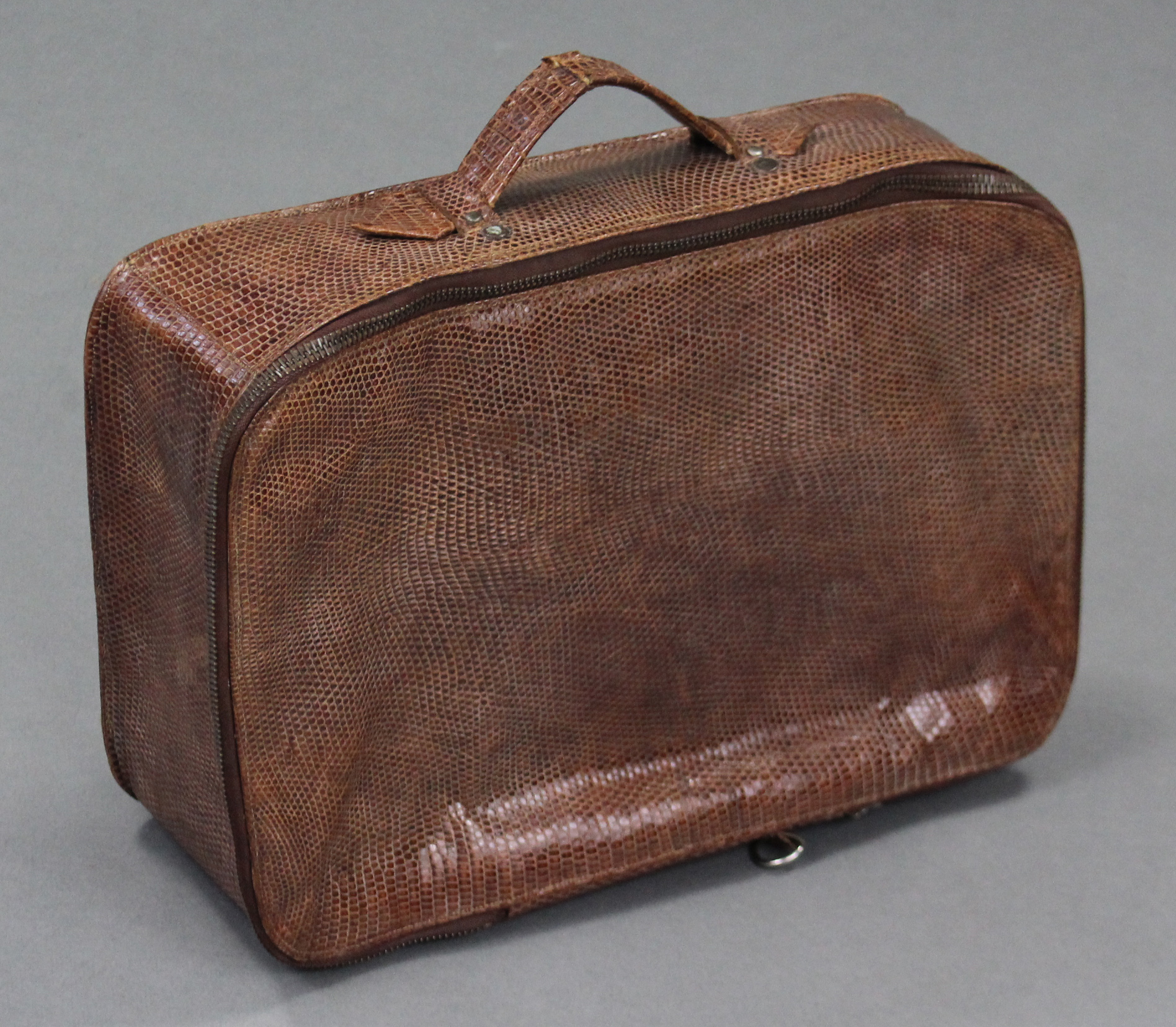Lot 13 - A snakeskin small suitcase with tan leather lining.