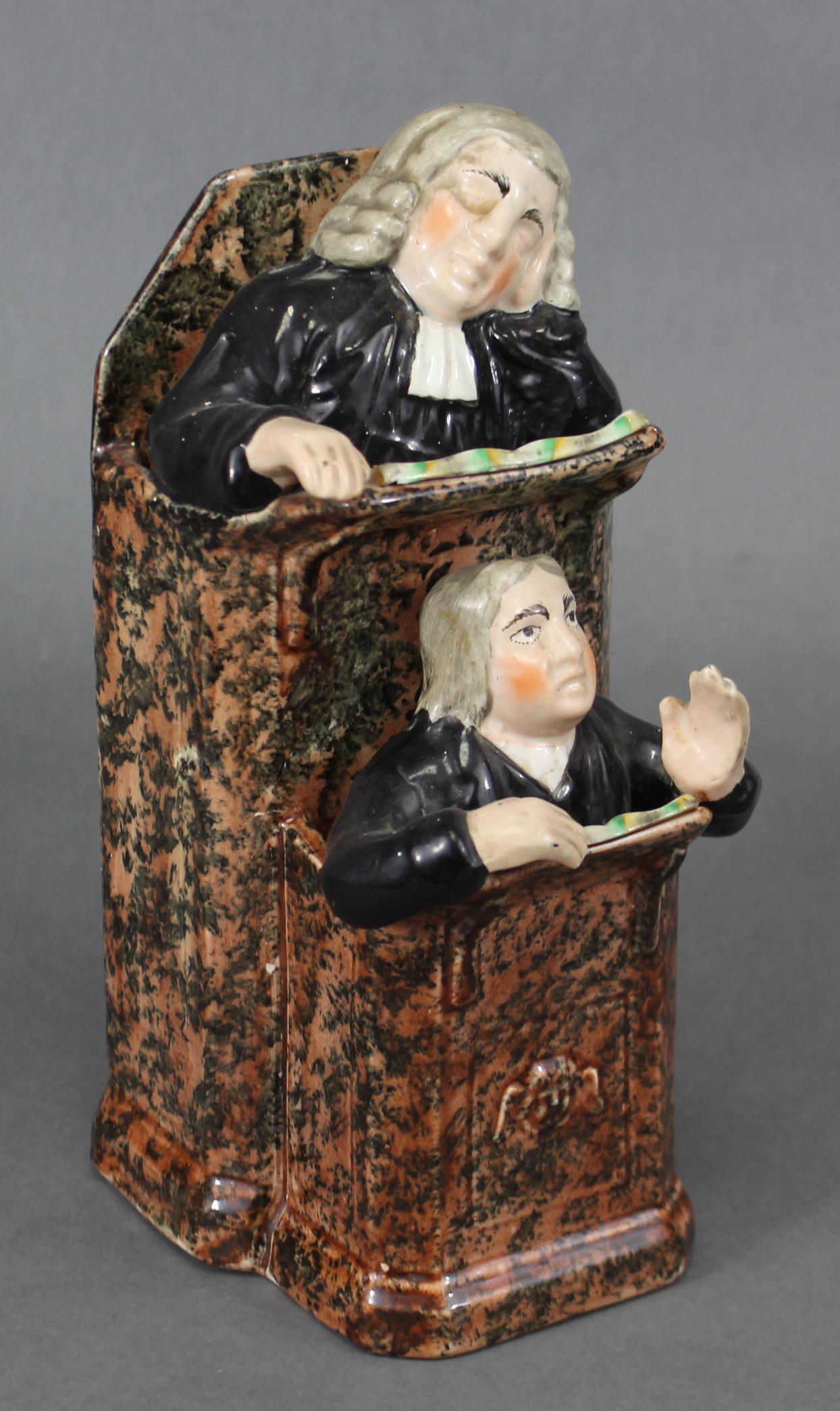 Lot 189 - An early 19th century Staffordshire creamware pulpit group of 'The Vicar & Moses', the pulpit with