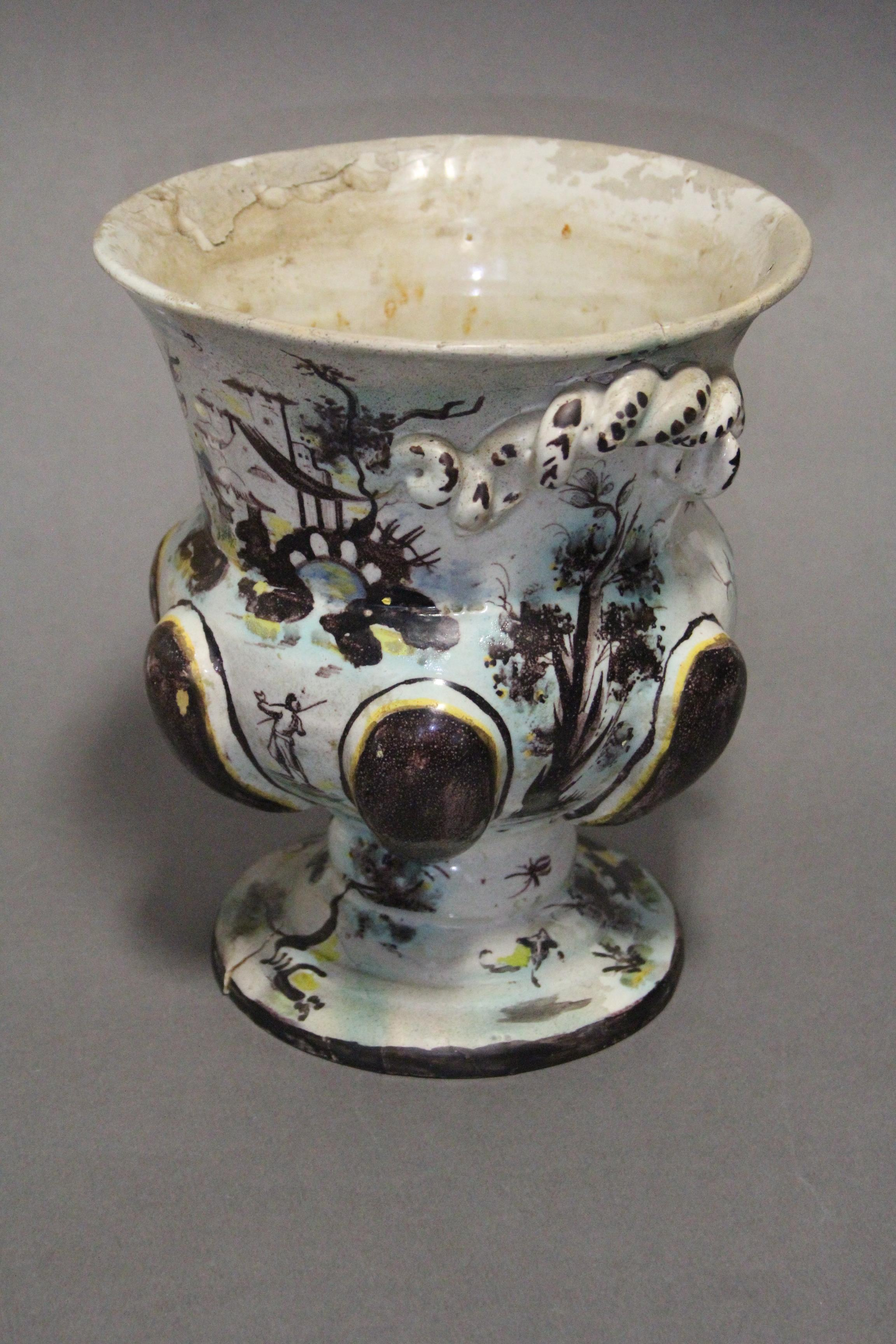 Lot 187 - A 17th/18th century continental faience urn-shaped vase with polychrome decoration of figure scenes,