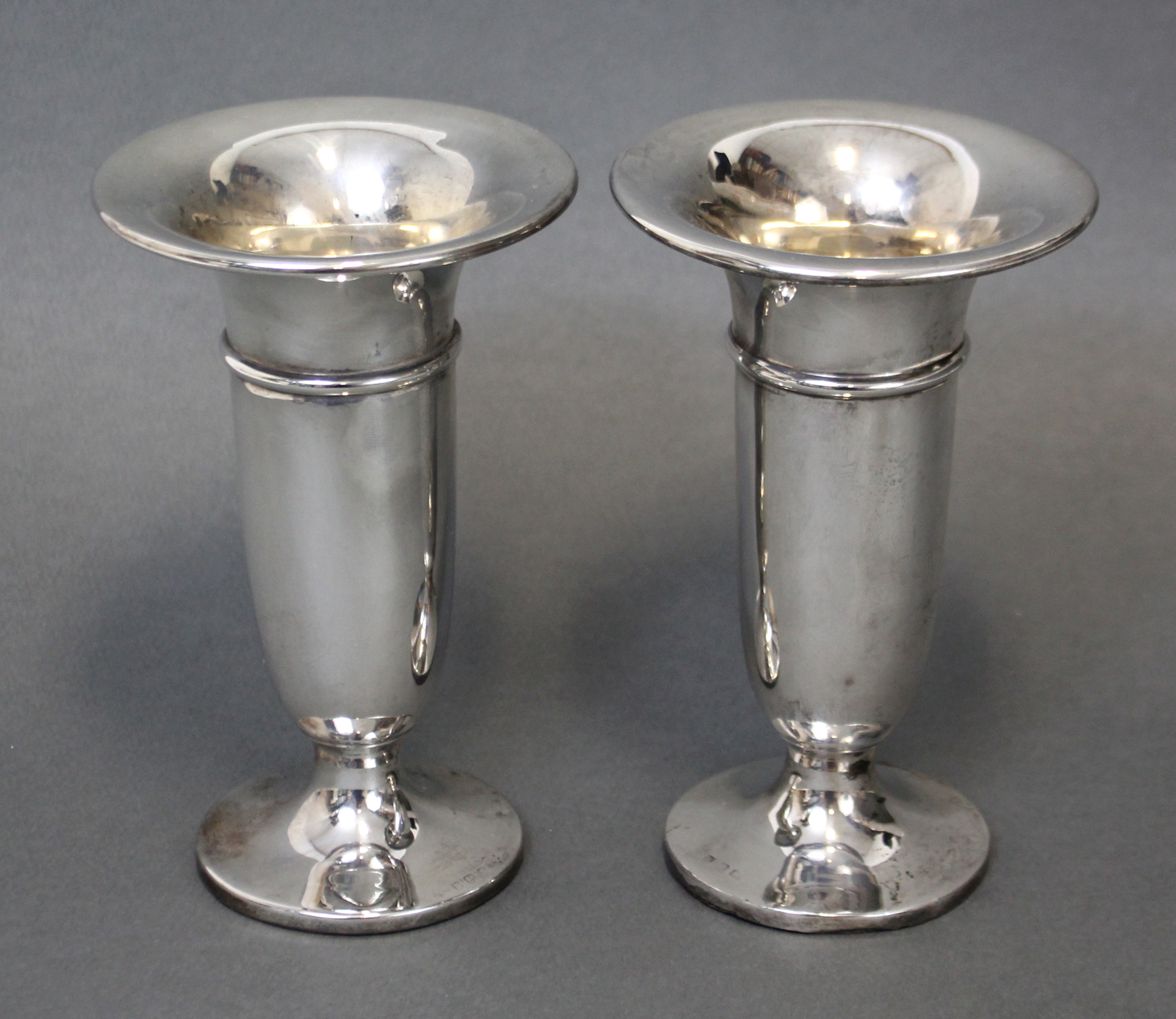 Lot 25 - A pair of Edwardian trumpet-shaped spill vases with wide flared necks, Birmingham 1902 (maker's