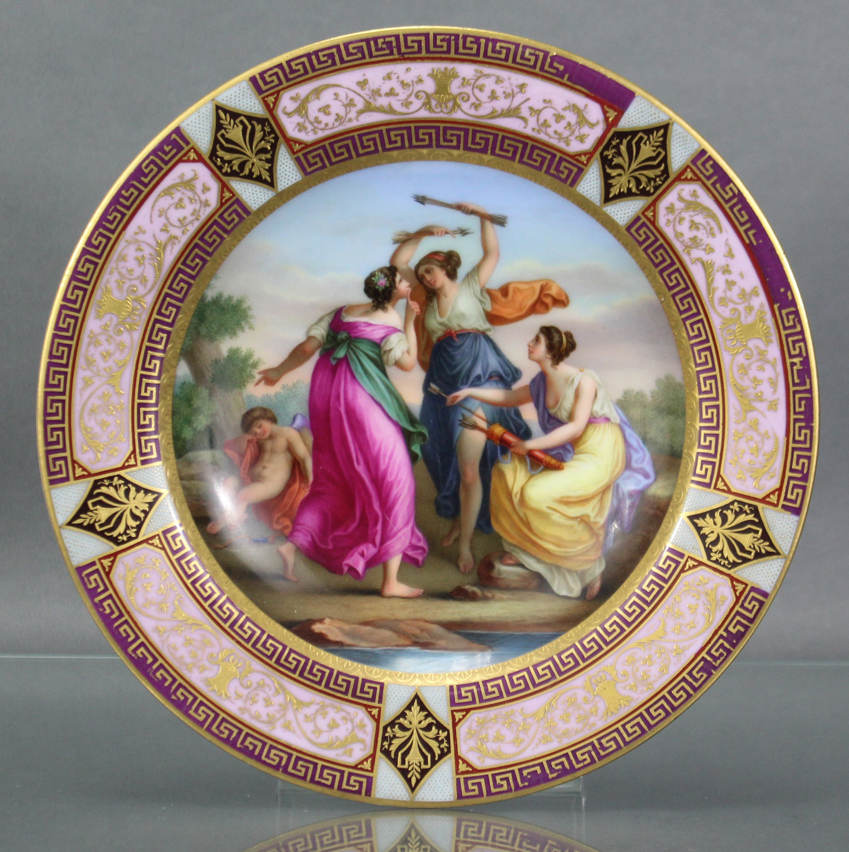 Lot 184 - A late 19th century Vienna porcelain cabinet plate, the centre with finely painted classical scene
