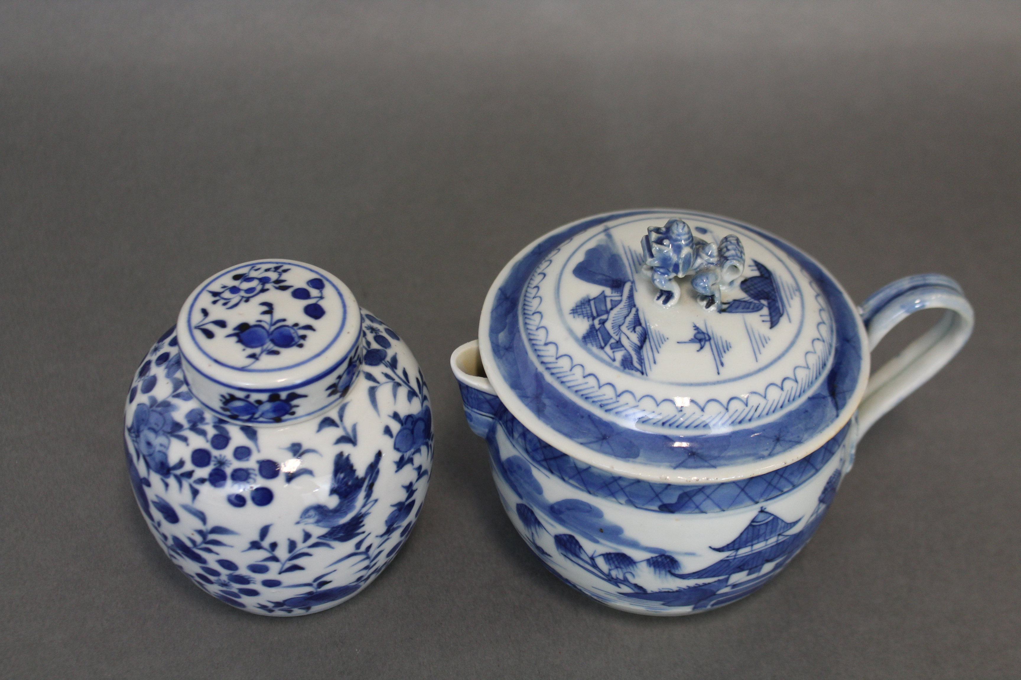 Lot 198 - A Chinese blue & white porcelain small jar & cover with all-over decoration of animals amongst