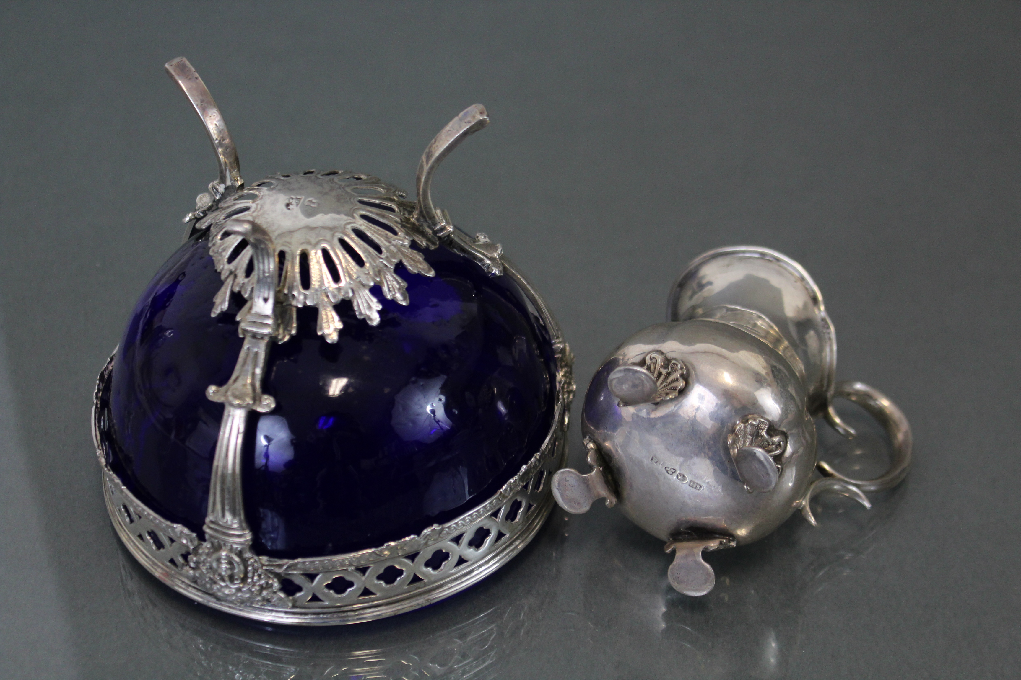 Lot 84 - A 19th century Swedish silver small jug of ovoid shape with flared rim, scroll handle & shell-shaped