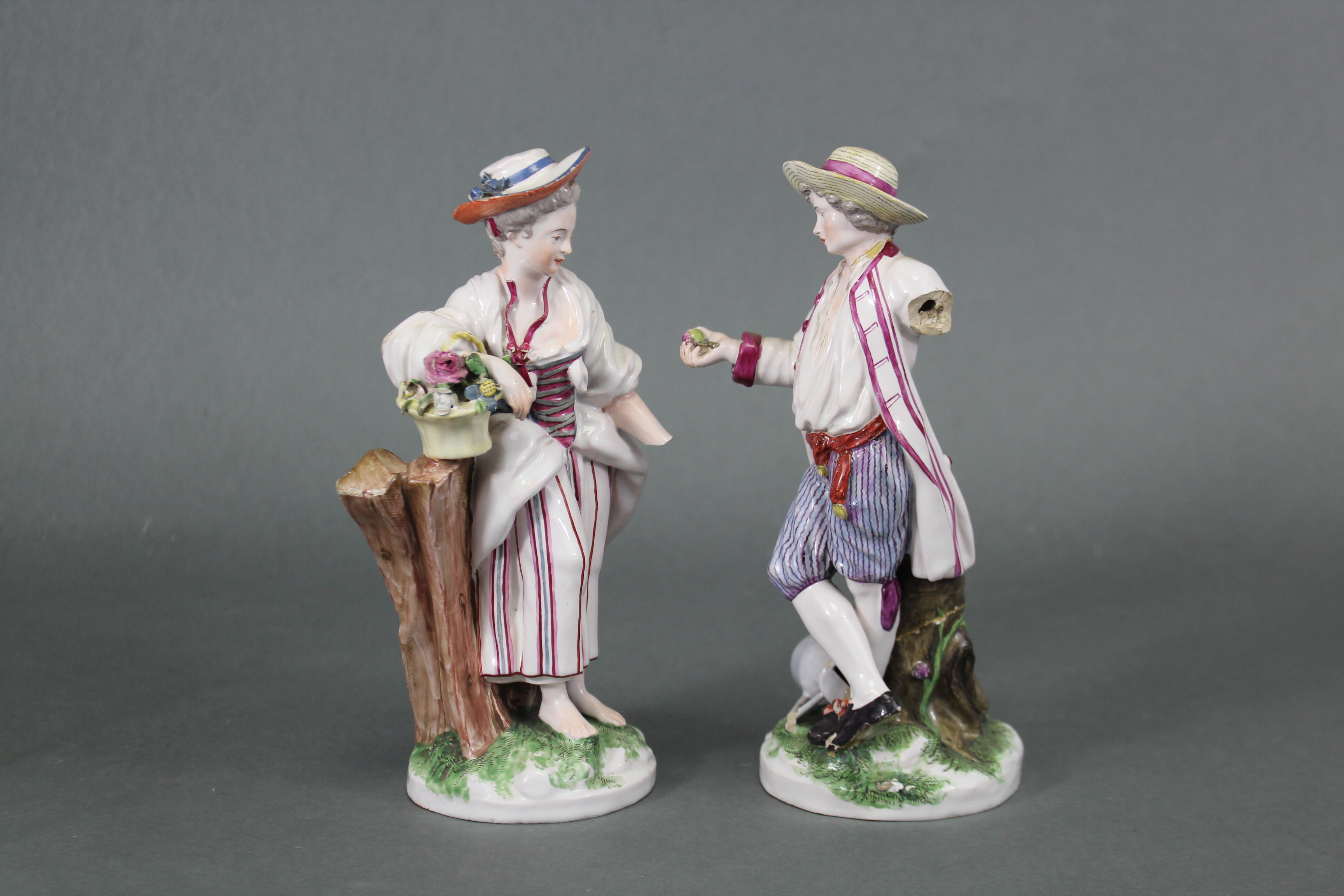 Lot 188 - A pair of late 18th century Niderviller faience male & female standing figures in rustic dress, he