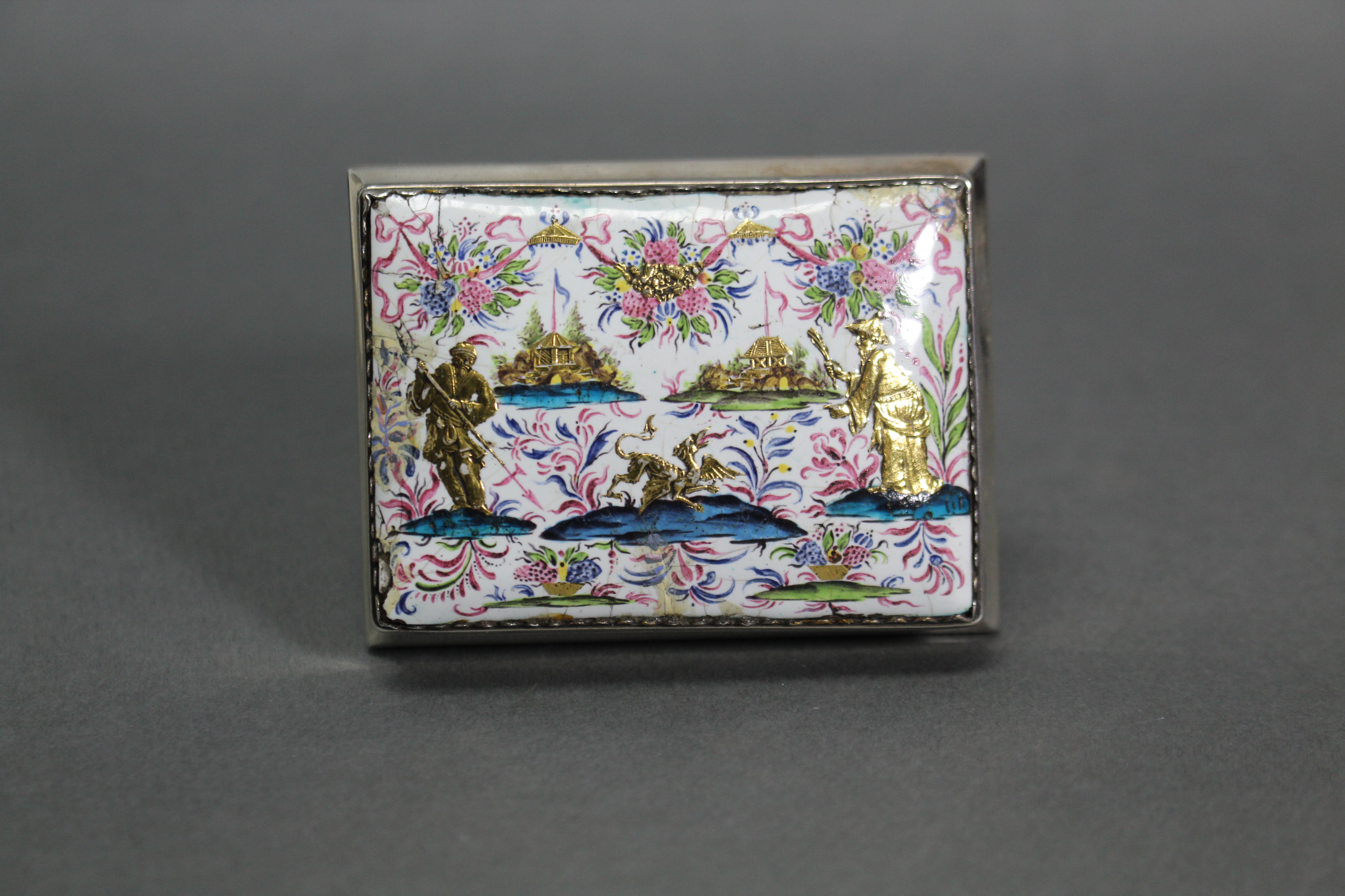 Lot 311 - AN 18th century CONTINENTAL SILVER & ENAMEL SNUFF BOX of rectangular shape with bombe sides, the