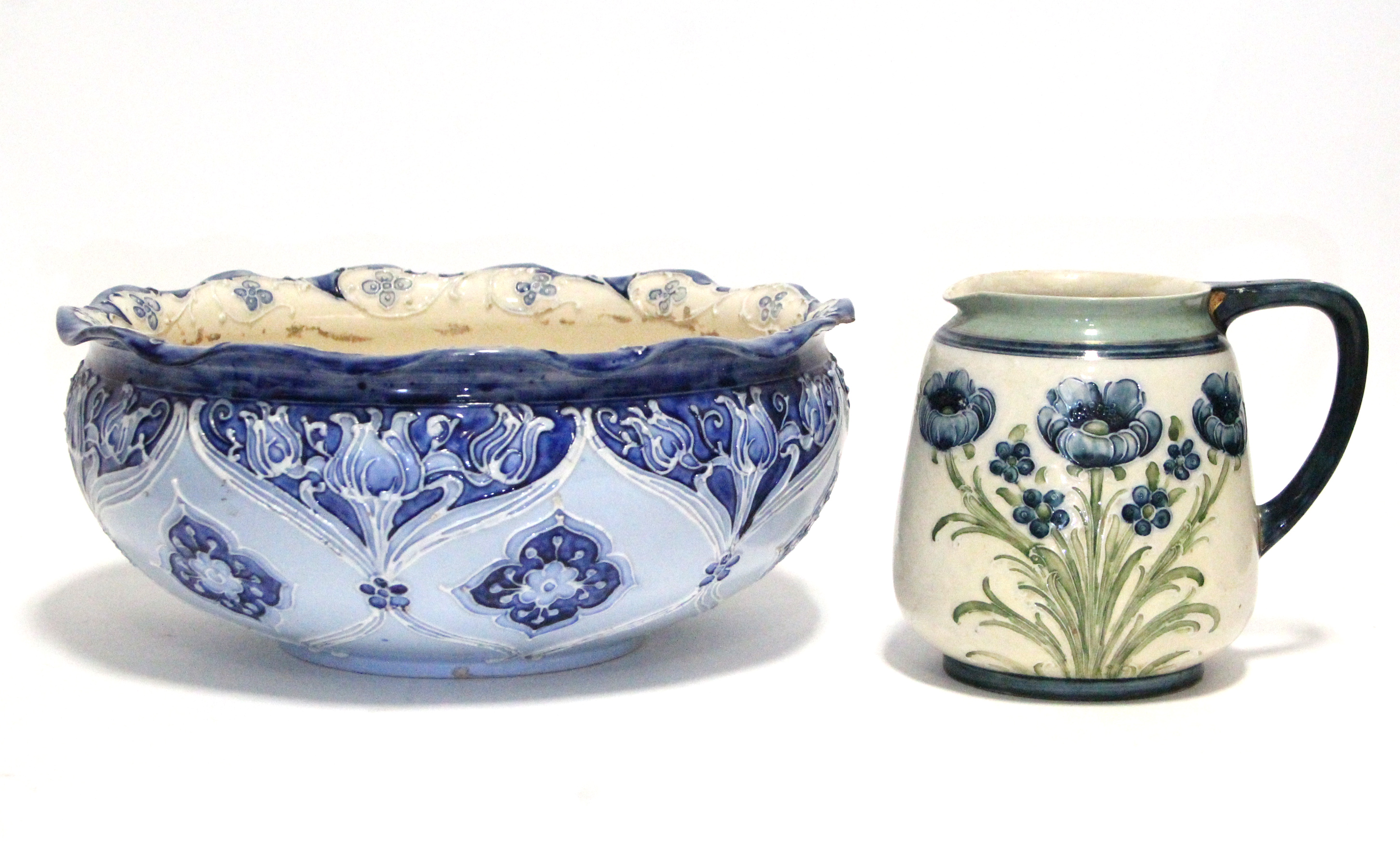 Lot 169 - A MacIntyre Florian Ware circular shallow bowl decorated in shades of blue with stylised tulips,