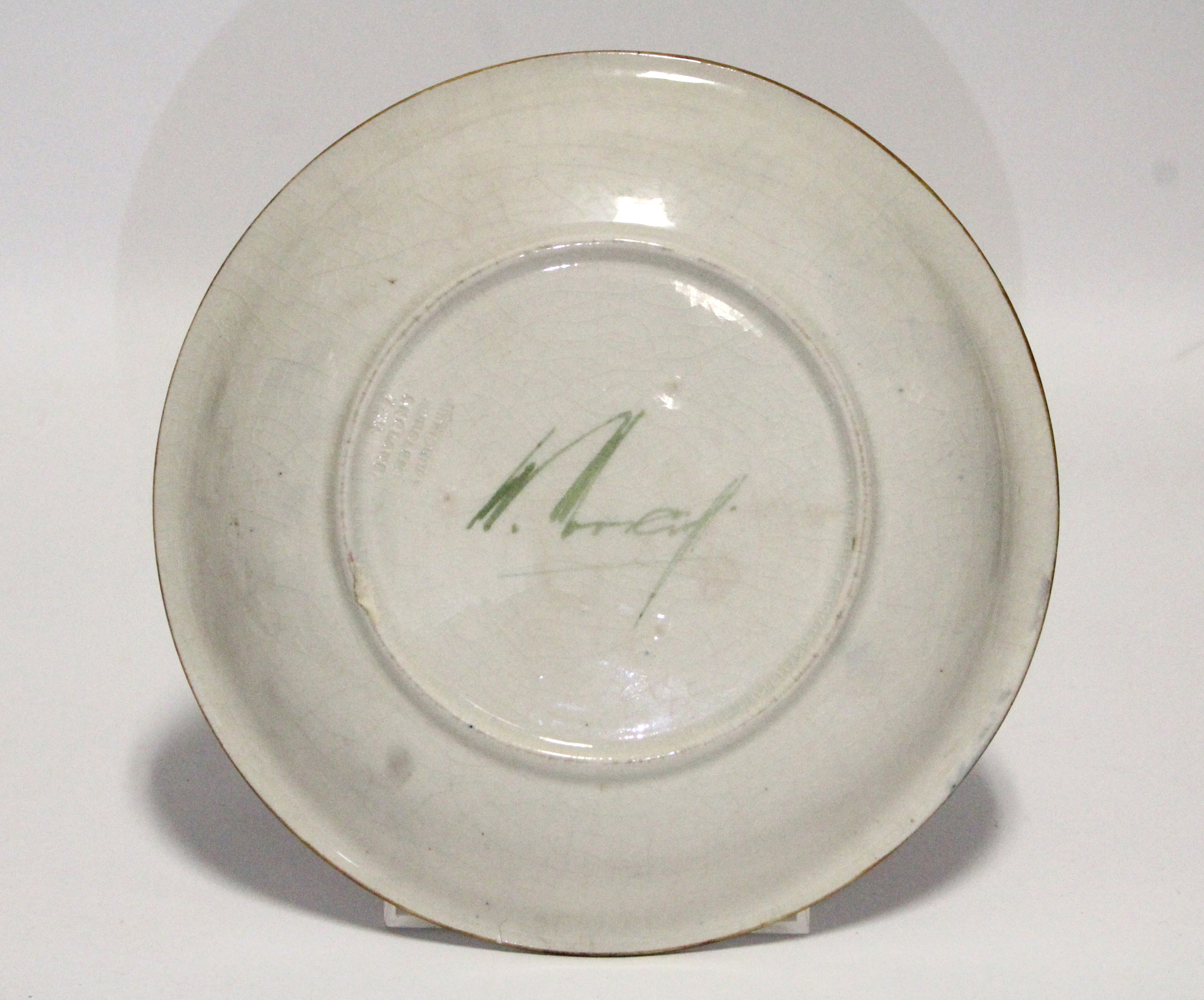 "Lot 168 - A Moorcroft ""Pomegranate"" shallow circular dish of blue/green ground, painted signature in green &"