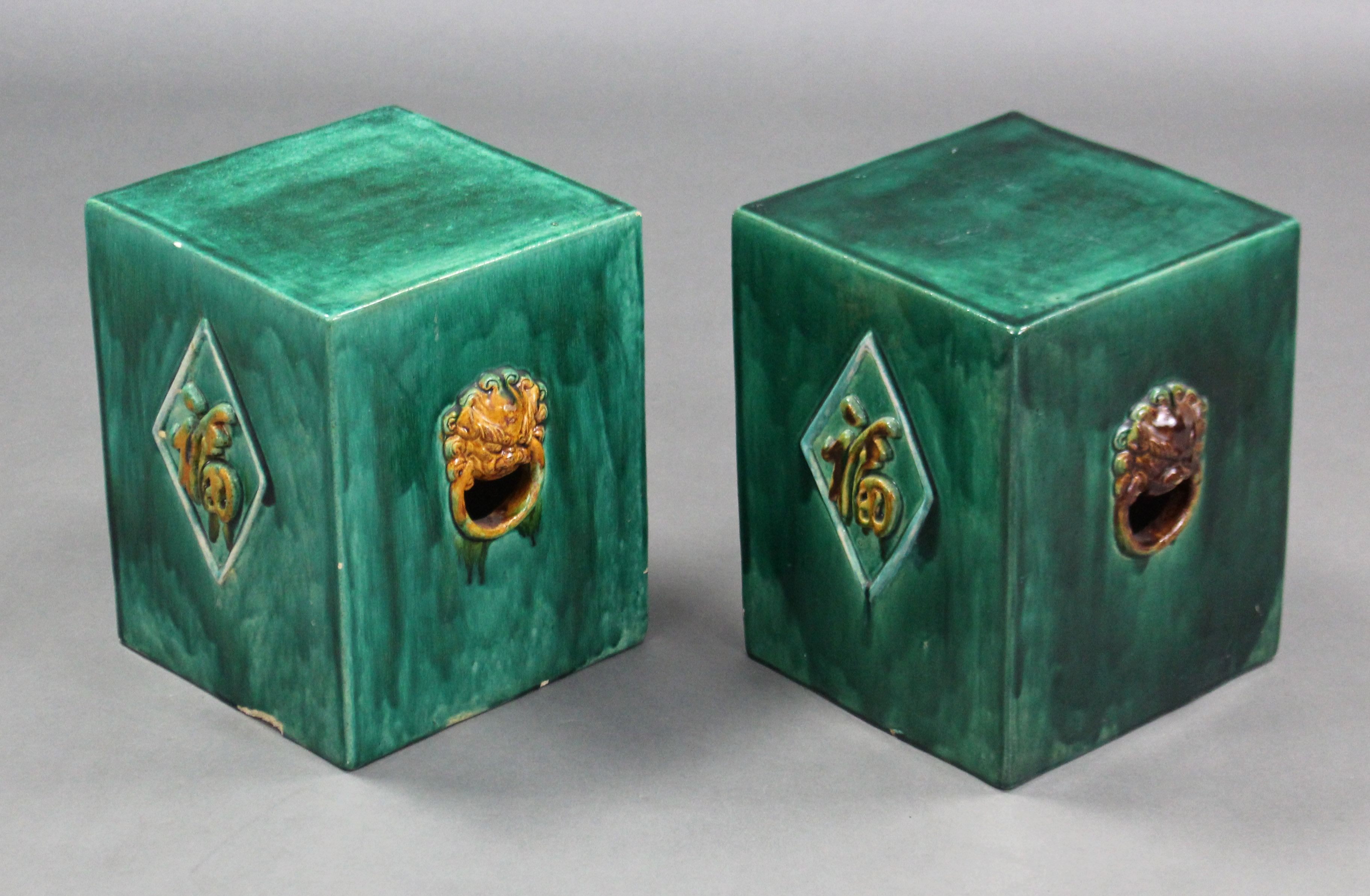 Lot 192 - A pair of green glazed Chinese pottery conservatory seats of rectangular form, with raised