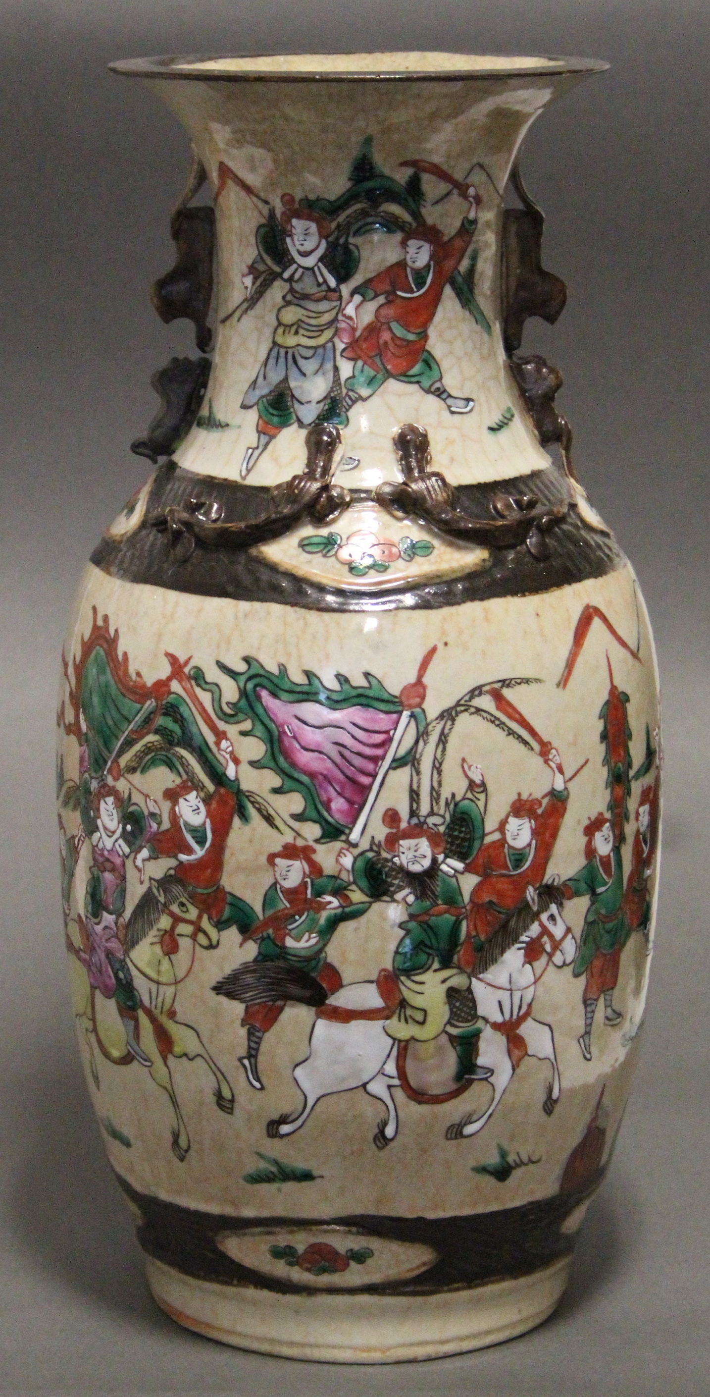 """Lot 193 - A Chinese """"crackleware"""" baluster vase with rose-verte enamel decoration of warriors on a cream"""