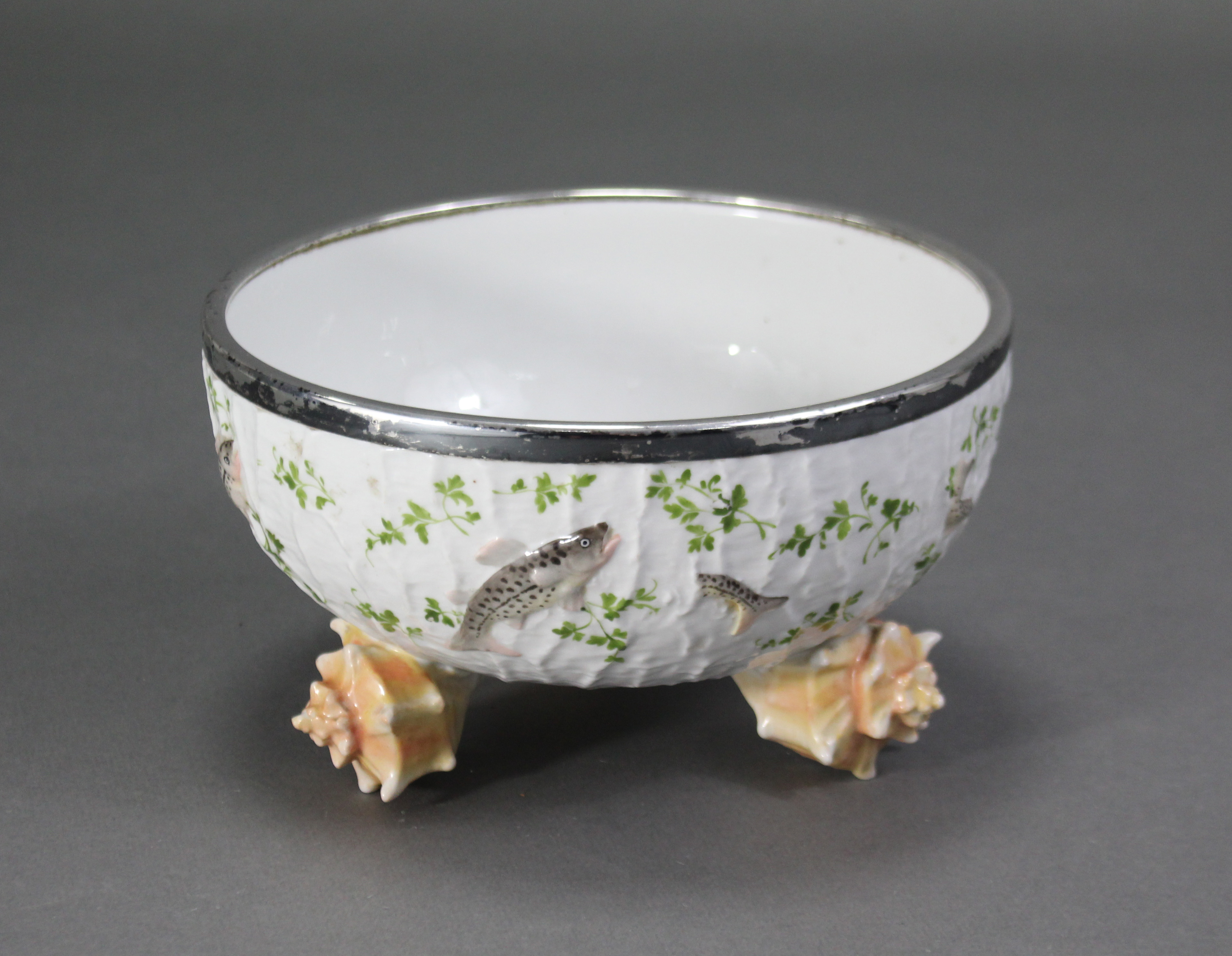 """Lot 173 - An early 20th century German porcelain bowl with silver-plated rim marked """"WMFN"""", the sides"""