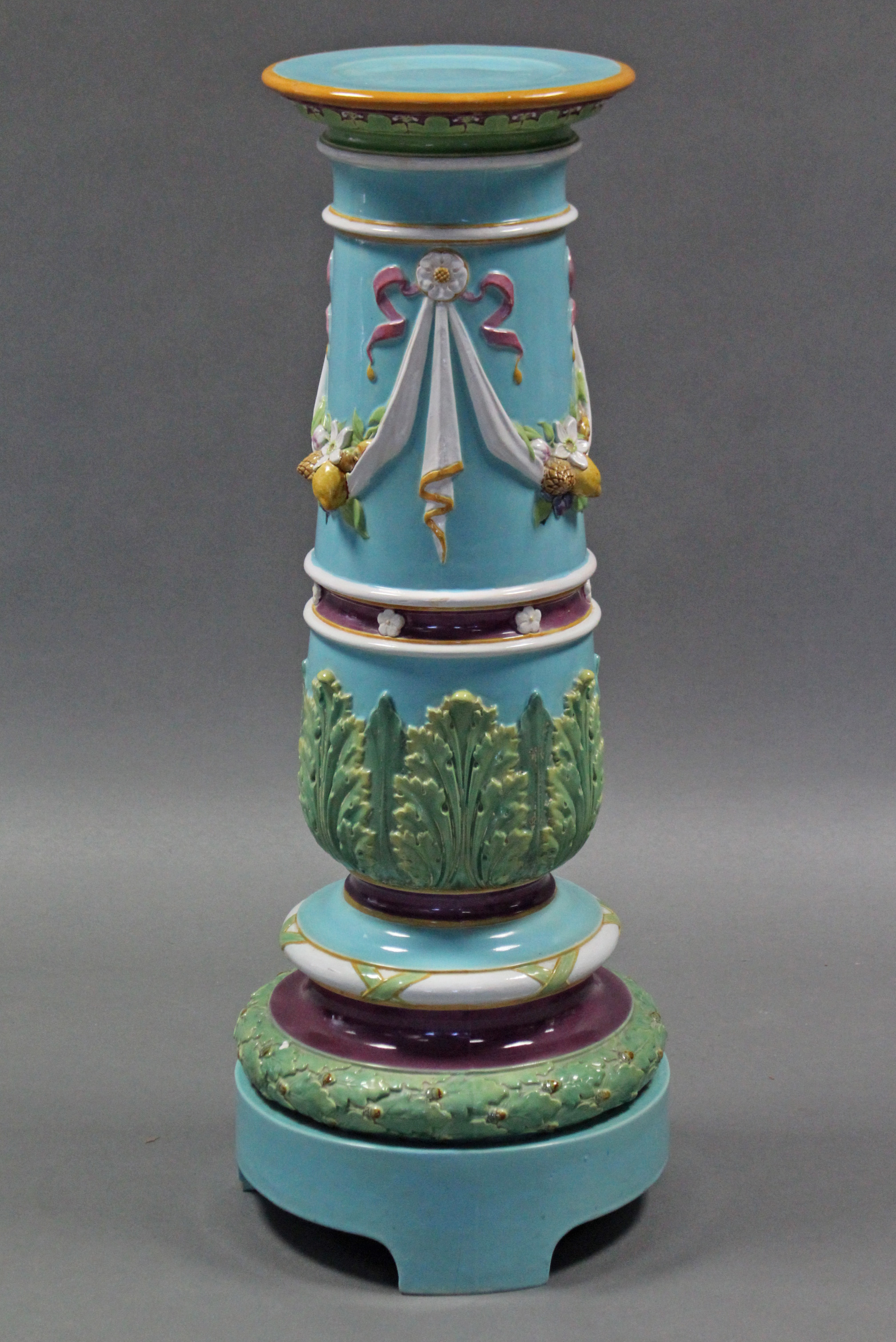 Lot 174 - A 19th century MINTON MAJOLICA JARDINIERE STAND, of pale blue ground, the tapered cylindrical body