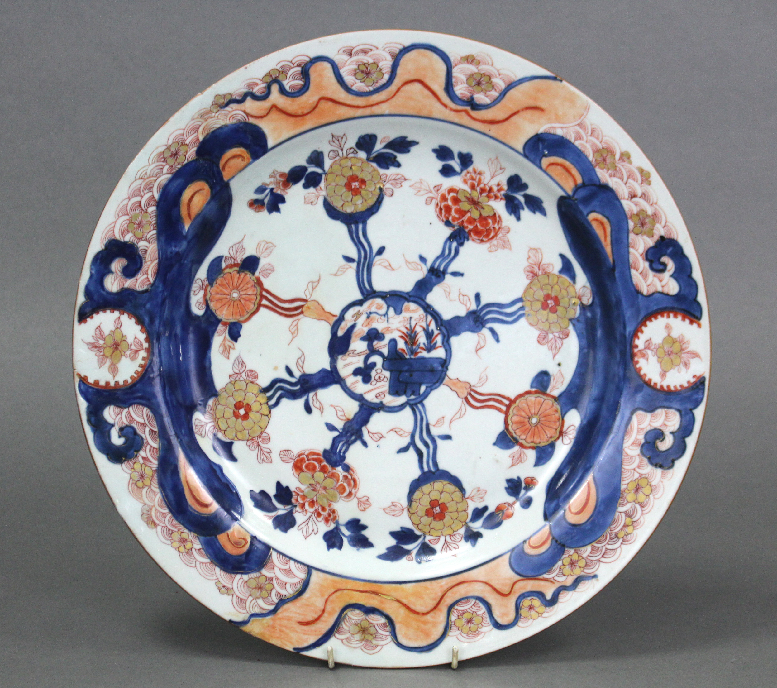 Lot 191 - An 18th century Chinese Imari porcelain charger, the centre with landscape decoration & stylised
