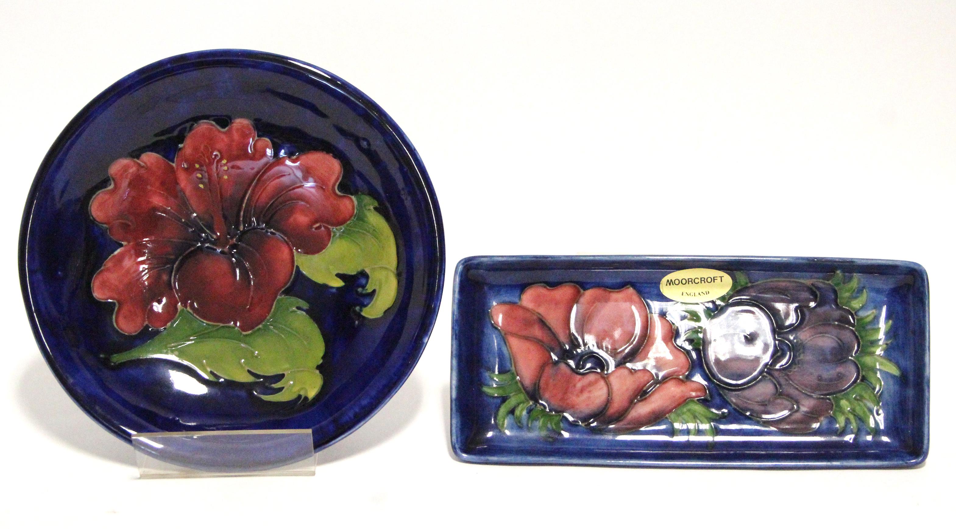 "Lot 170 - A modern Moorcroft ""Anemone"" rectangular shallow dish of mid-blue ground, 8"" x 3½""; & a ""Hibiscus"""