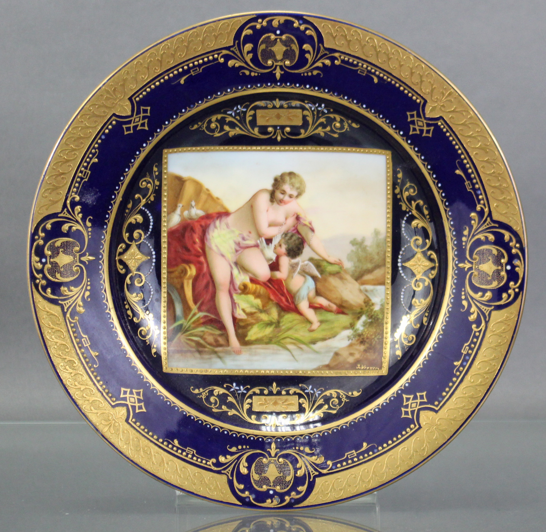 Lot 183 - A late 19th century Vienna porcelain cabinet plate, the centre with finely painted square panel