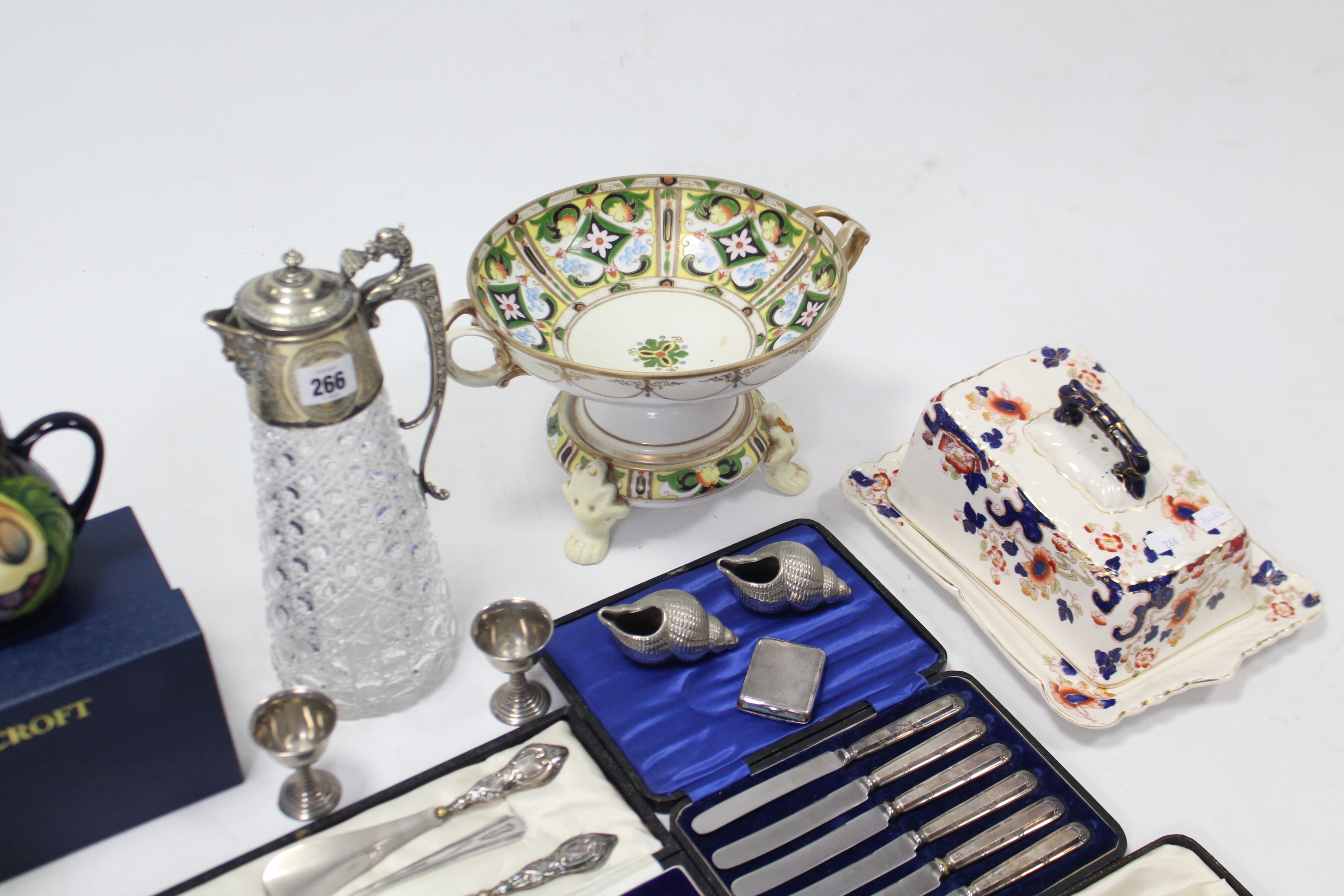 Lot 266 - A heavy cut-glass claret jug with plated mounts; various items of plated cutlery (cased); various
