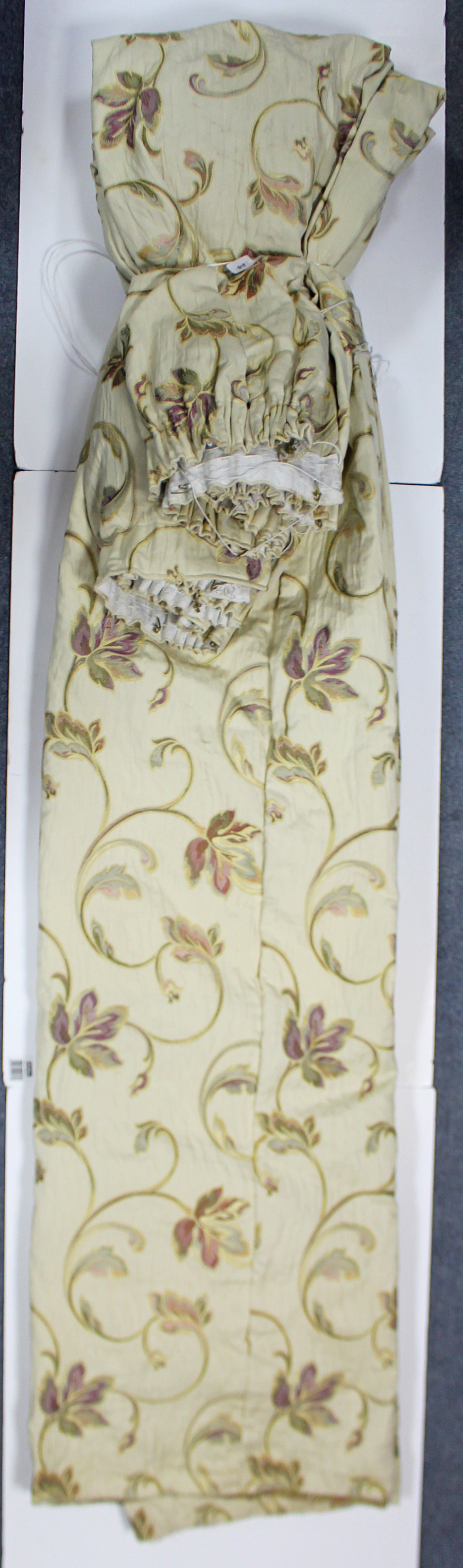 Lot 32 - A pair of lined & interlined curtains of cream ground, & with all-over repeating multi-coloured