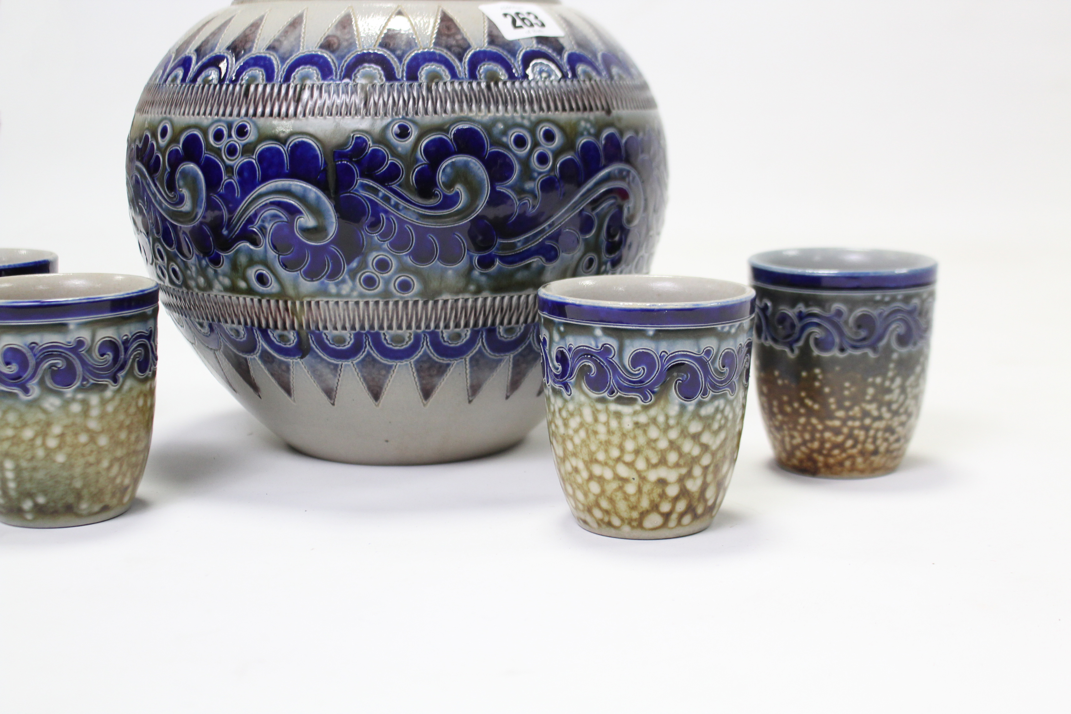 """Lot 263 - A German stoneware Rumtopf with stylised geometric design, 10½"""" high & a ditto set of four cups."""
