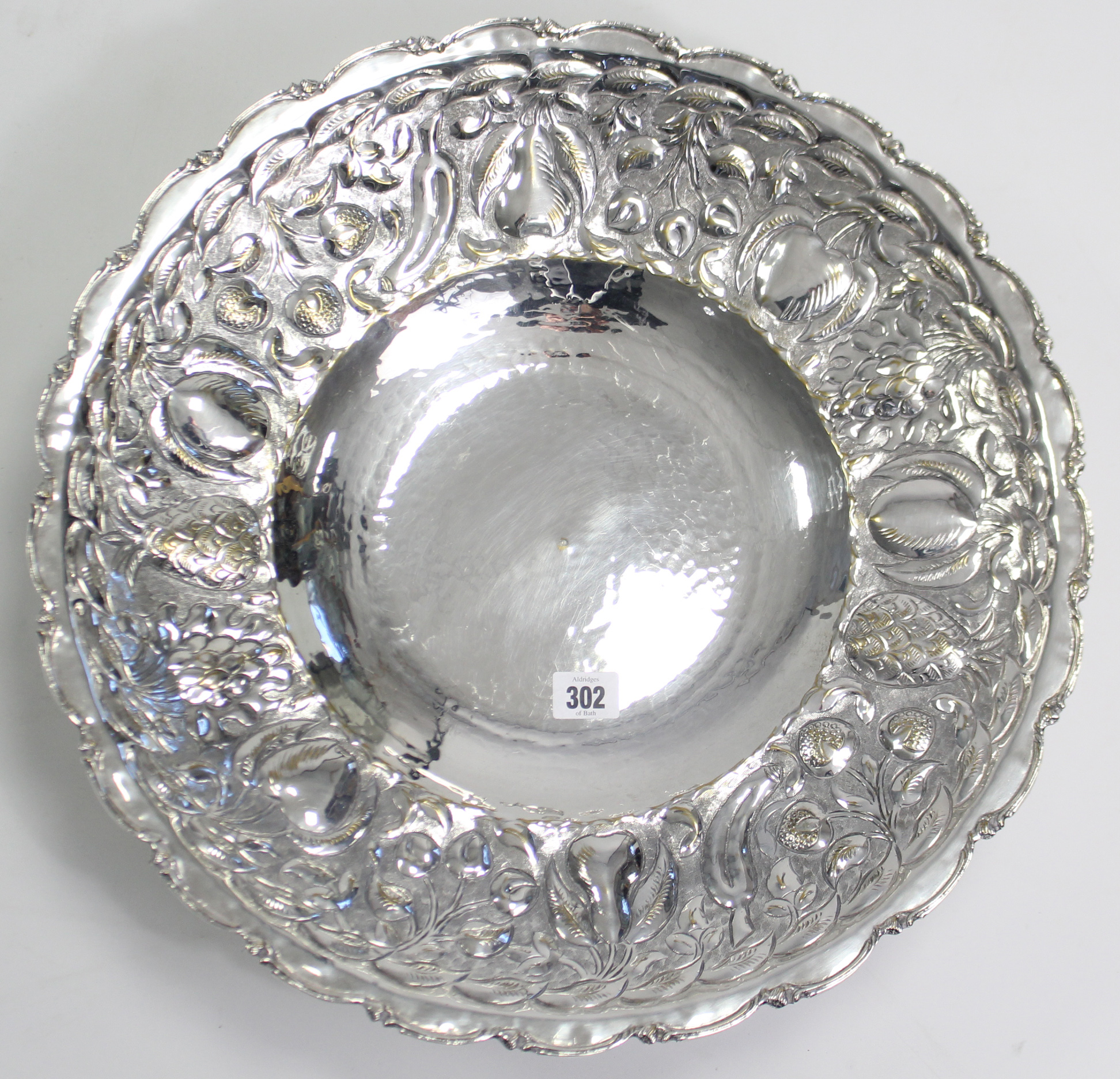 Lot 302 - A large silver plated circular comport with embossed fruit border, & on round pedestal foot, 19""