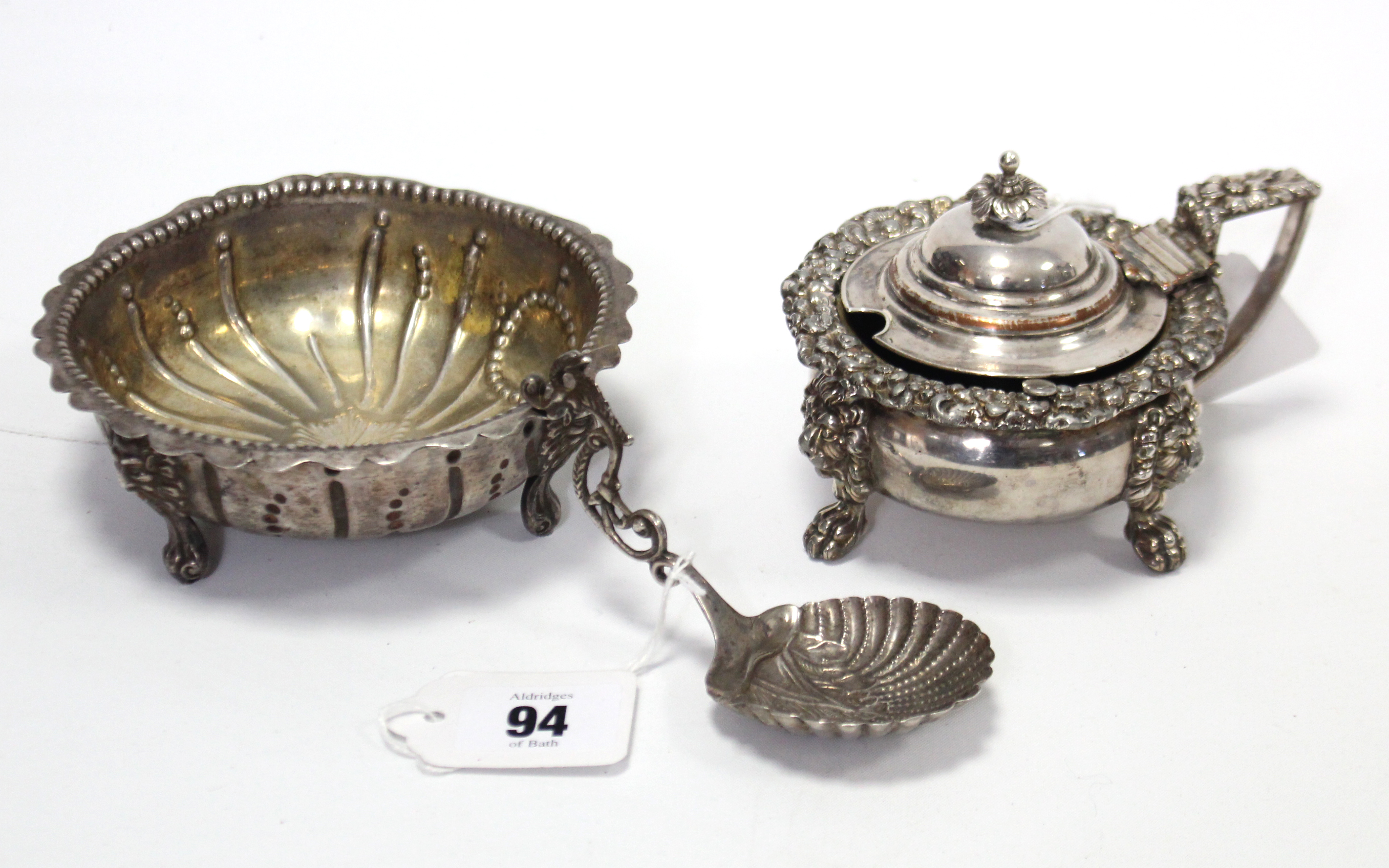 Lot 94 - A late Victorian silver sugar bowl of fluted circular design & on three short cabriole legs, 4¾""