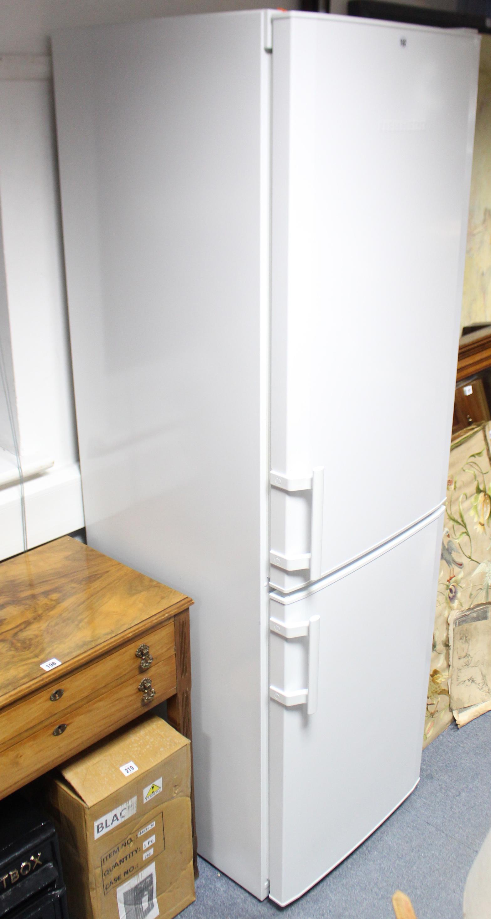 "Lot 192 - A Liebherr upright fridge-freezer in white finish case, 21"" wide x 70¾"" high."