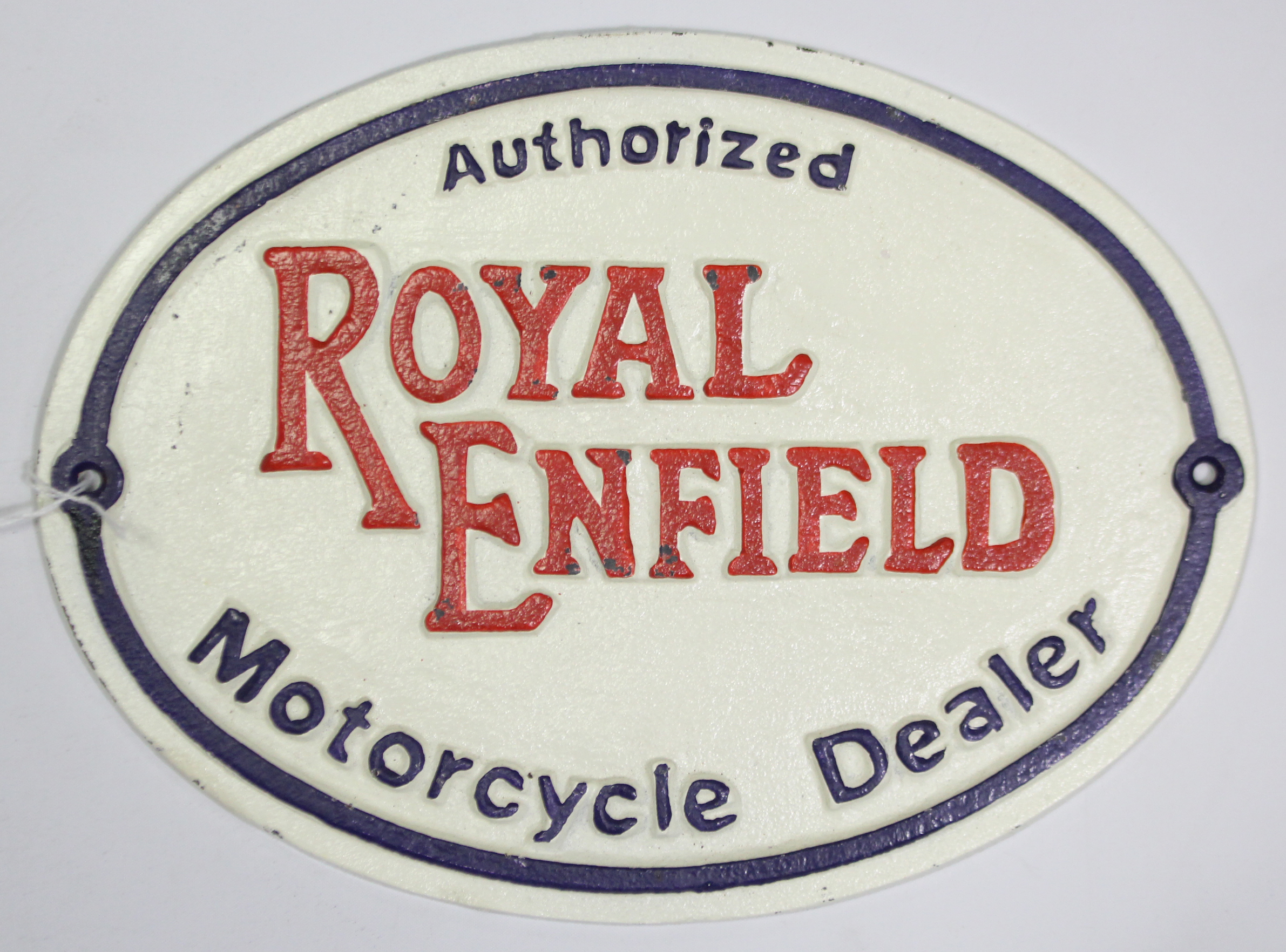 "Lot 68 - A reproduction painted cast-iron oval sign ""Authorised ROYAL ENFIELD Motorcycle Dealer"", 8"" x 11""."