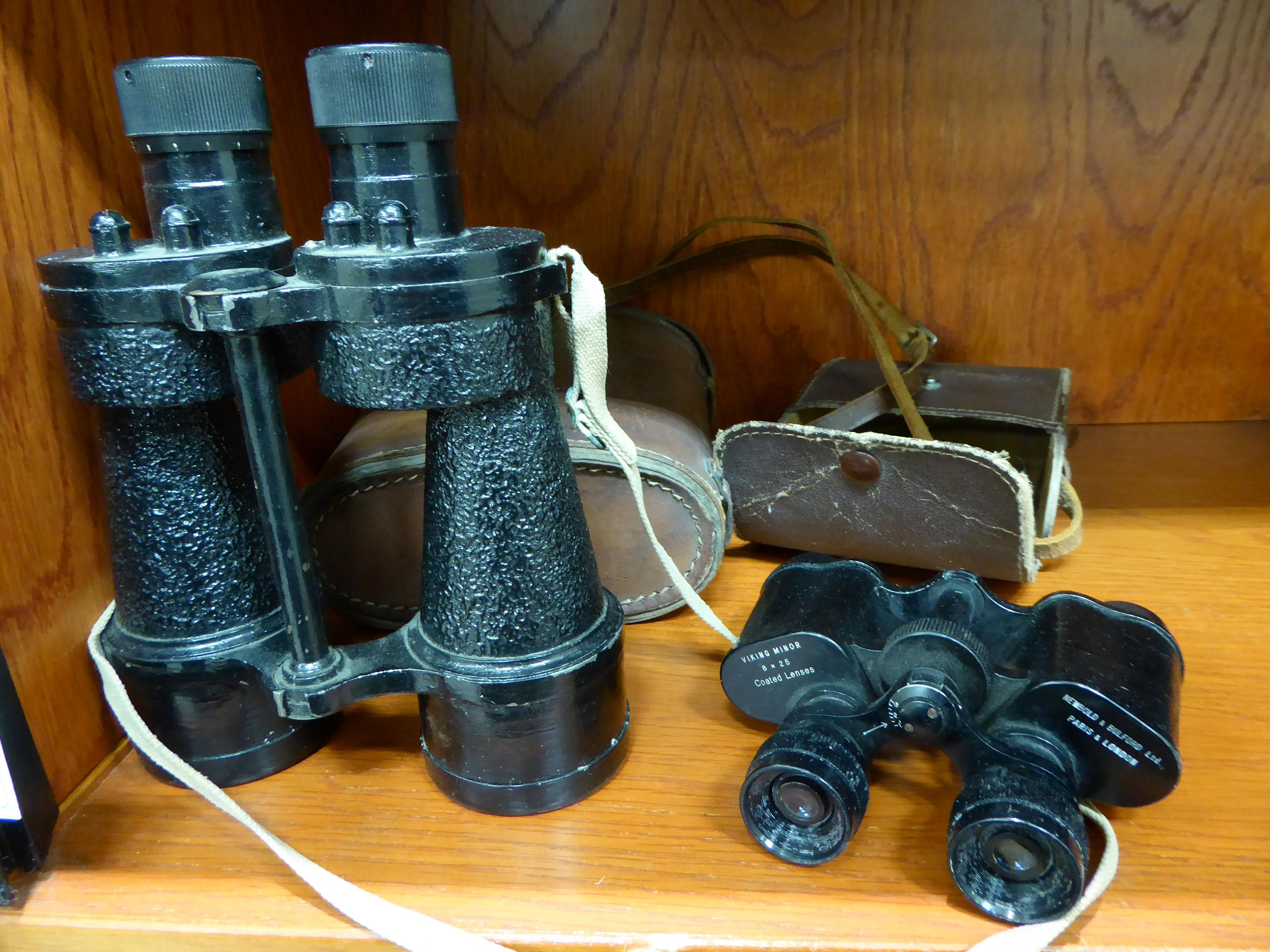 Lot 144 - A pair of Newbold & Bulford 8x25 binoculars; and a pair of Bino Prism No.