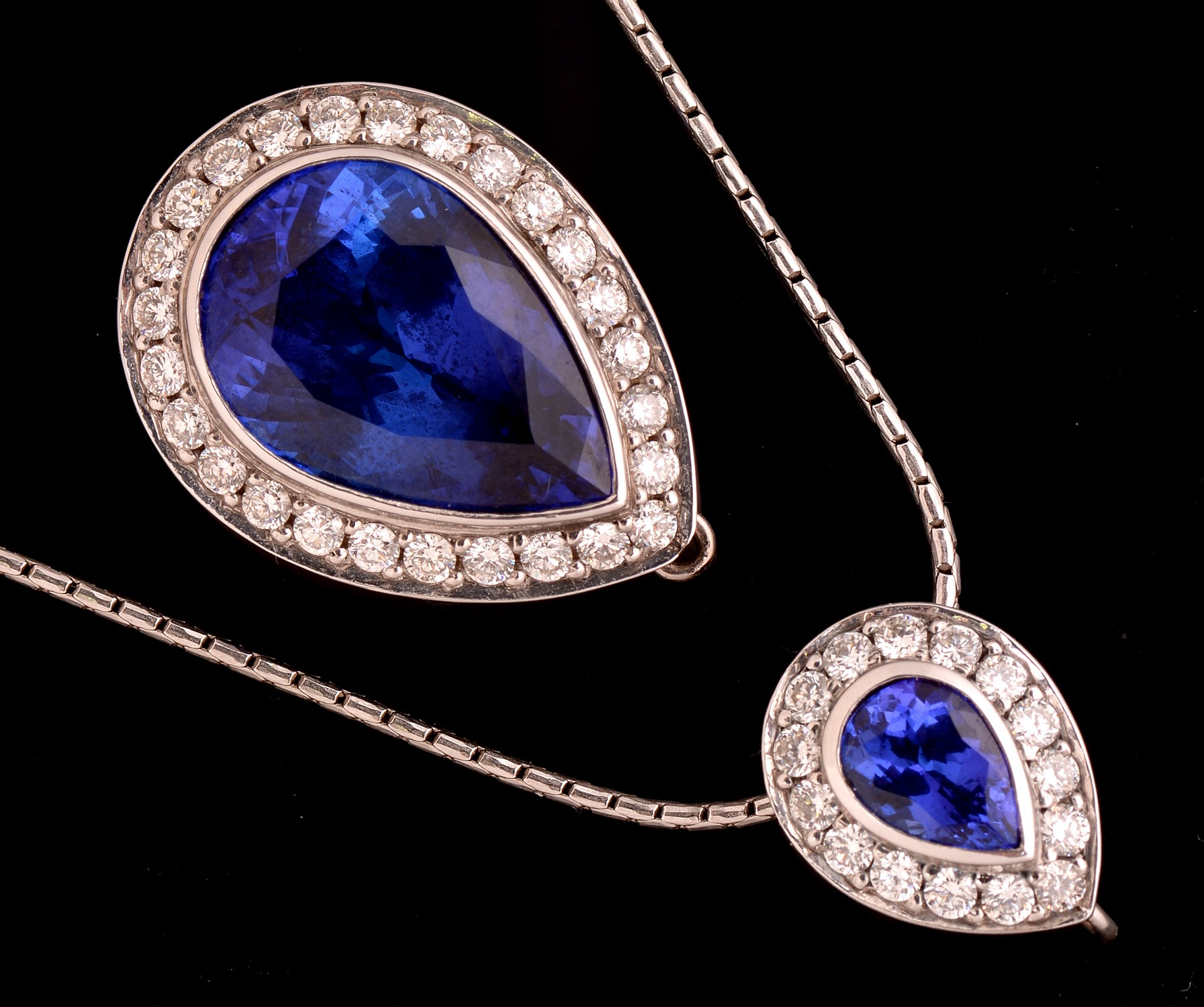 Lot 491 - Tanzanite and diamond pendant