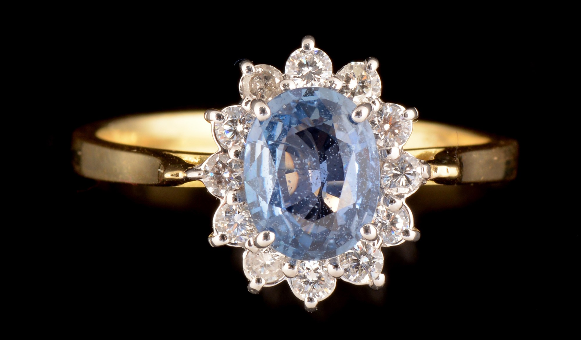 Lot 519 - Sapphire and diamond ring