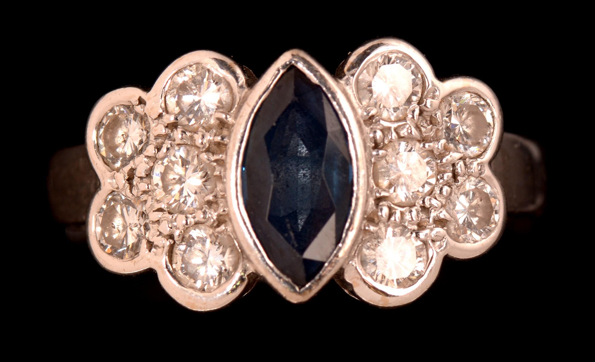 Lot 488 - Sapphire and diamond ring