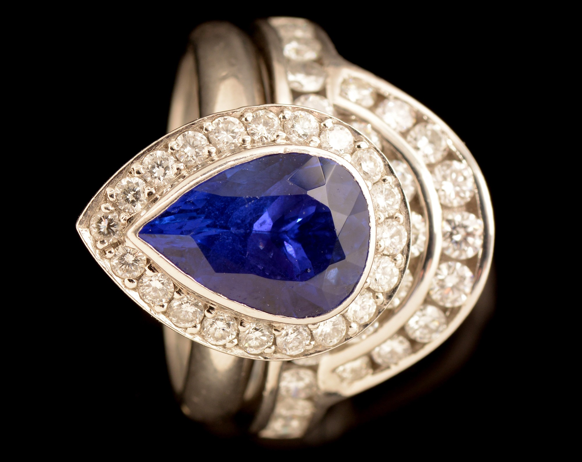 Lot 530 - Tanzanite and diamond ring and matching diamond ring