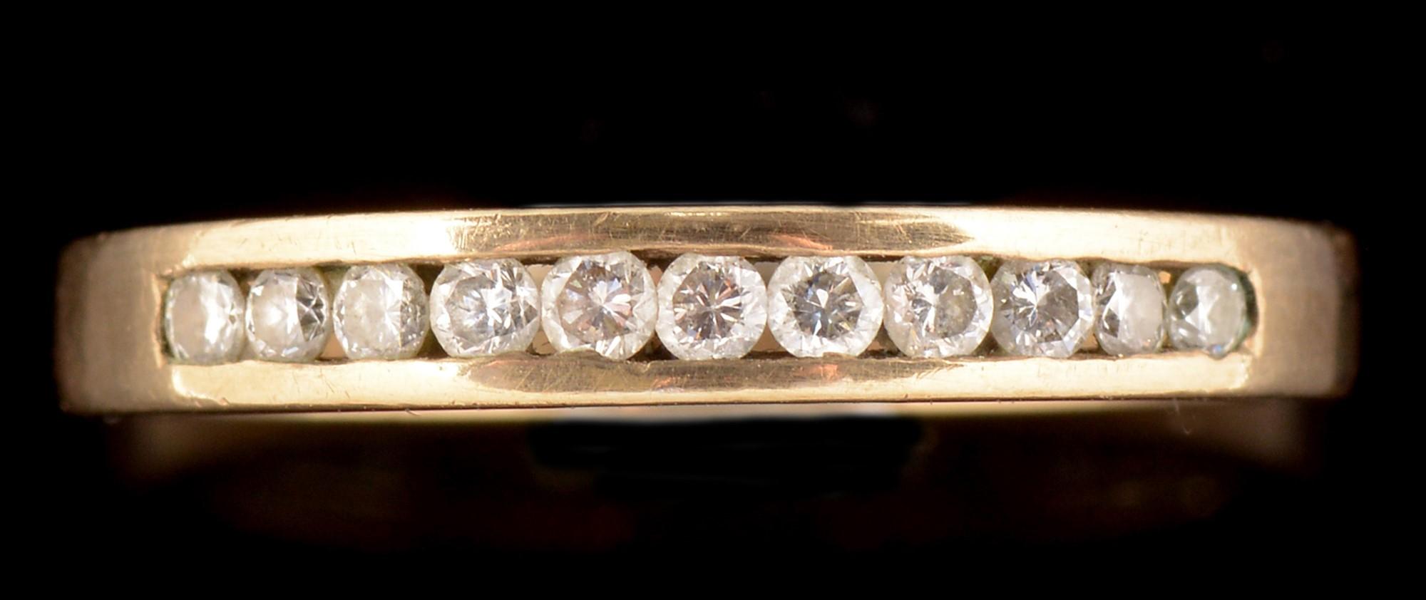 Lot 523 - Diamond half hoop eternity ring