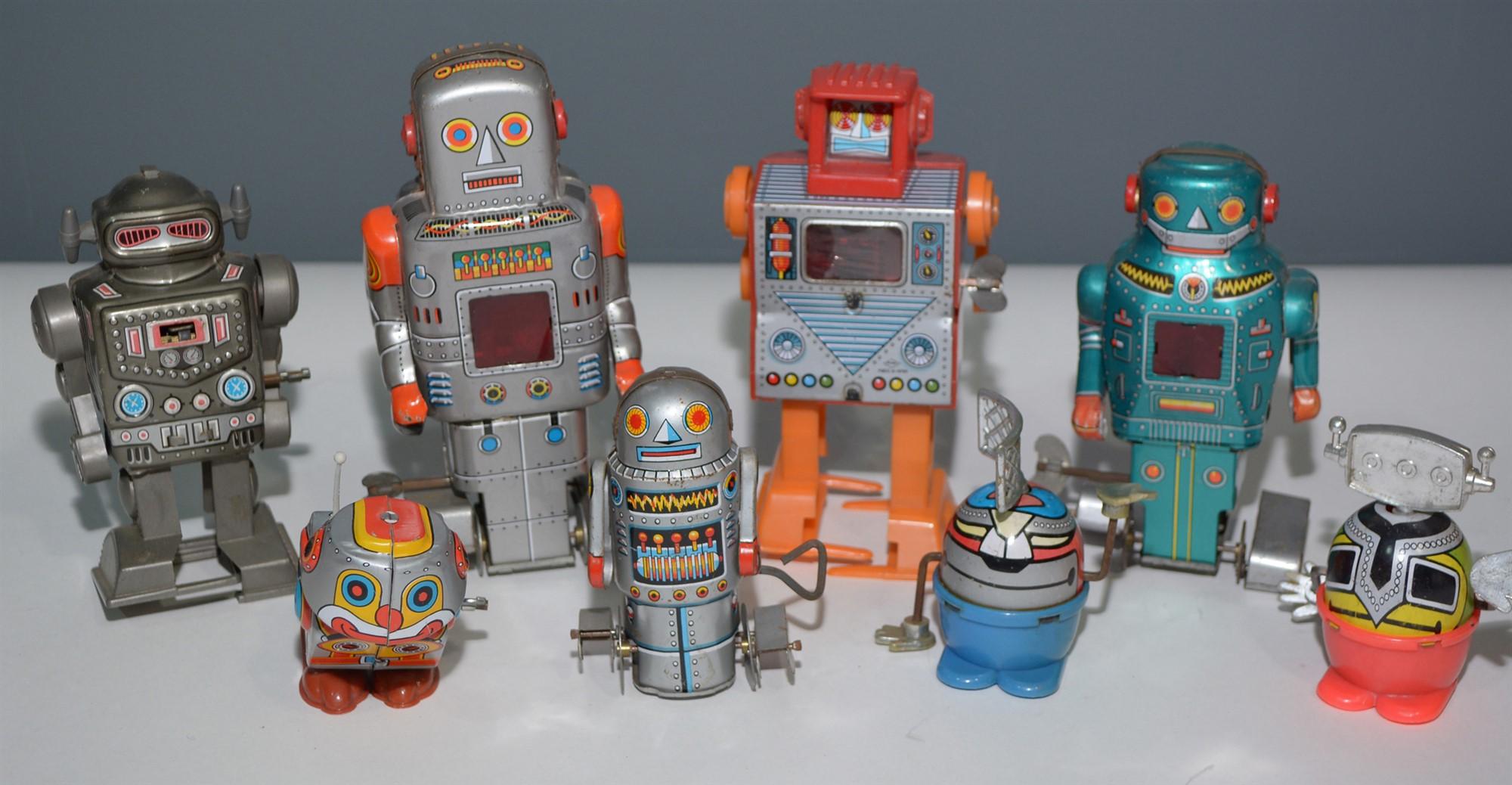 Lot 1053 - Small tin plate robots