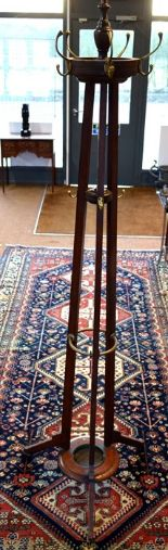 Lot 549 - A late 19th/20th century brass fitted mahogany railway cloak stand, the top revolving over a central