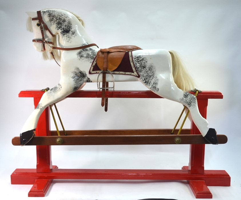 Lot 825 - A traditional wooden rocking horse