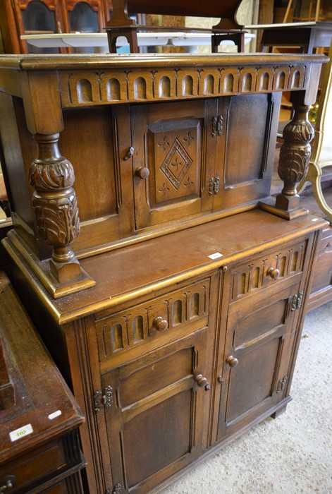 Lot 22 - An Old Charm style carved oak court cupboard