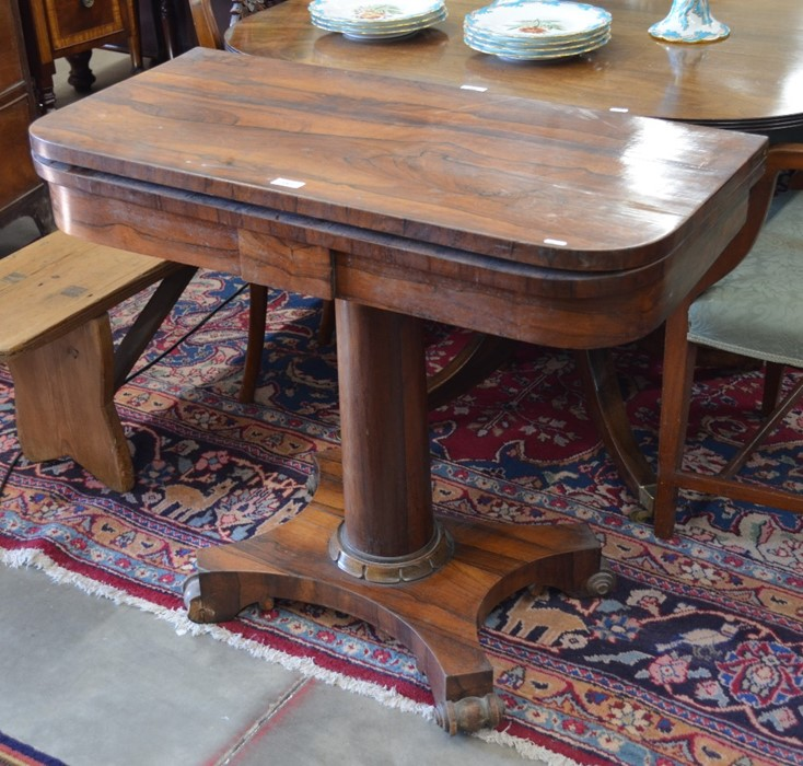 Lot 8 - A Victorian rosewood card table with folding baize-lined top raised on a turned column and concave