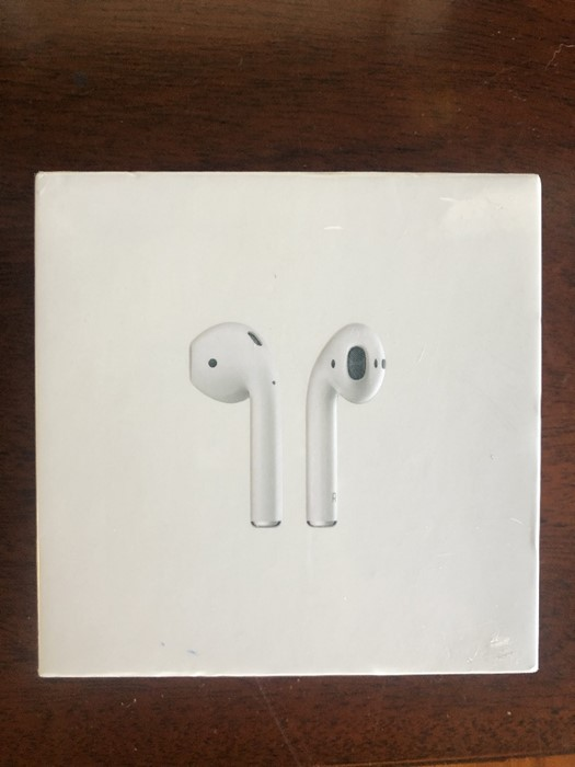 Lot 50H - Police recovered items - A pair of Apple Airpods with charging case, white, second generation, in