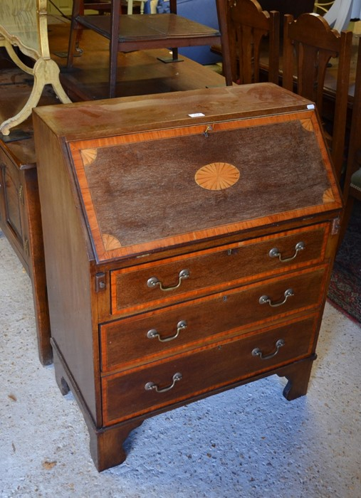 Lot 23 - An Edwardian inlaid mahogany Sheraton style fall front bureau with fitted interior over three
