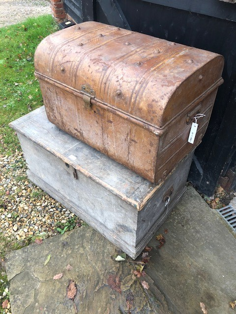 Lot 1 - An antique stained pine trunk to/with two old dome top tin trunks (3)