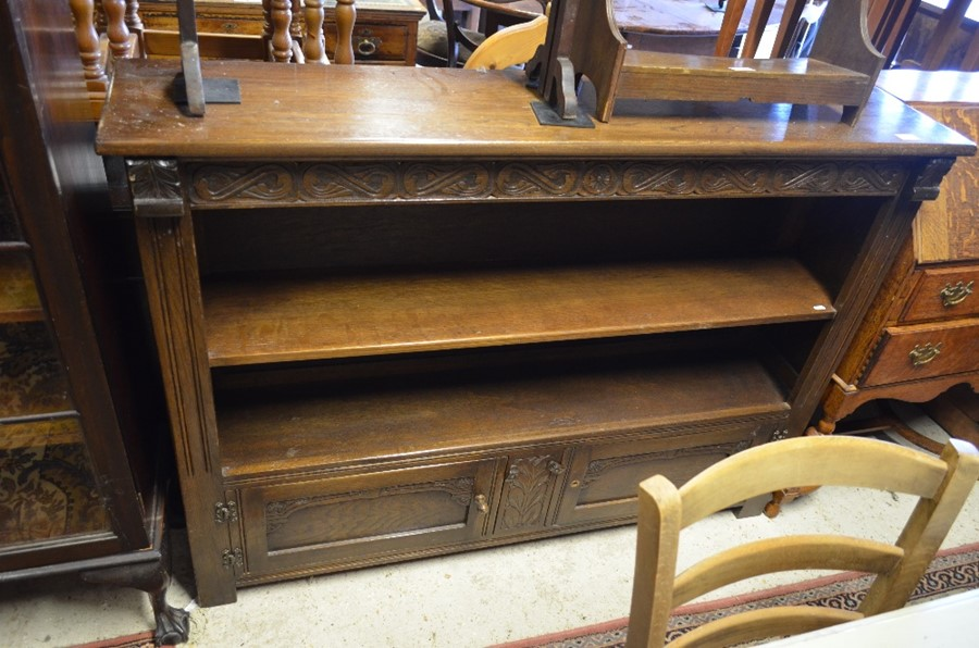 Lot 11 - An Old Charm style oak cabinet with a single open shelf and panelled cupboard doors (A/F)