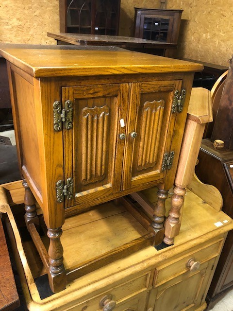 Lot 42 - An Old Charm brand linen-fold design side cabinet with pot board to/with a matching cabinet (2)