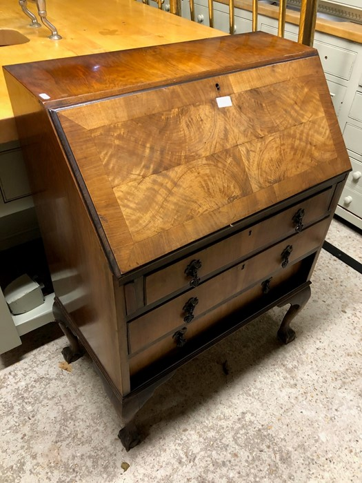 Lot 3 - An old walnut bureau