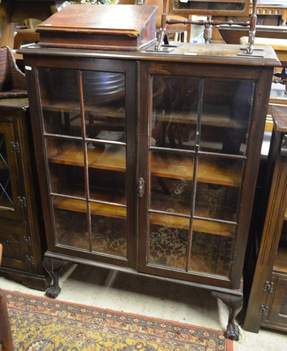 Lot 26 - A mahogany bookcase with a pair of glazed doors enclosing three shelves, raised on cabriole supports