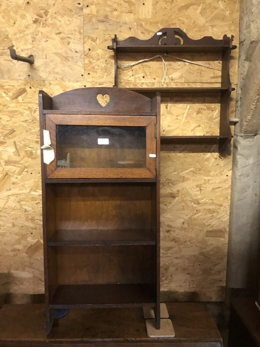 Lot 51 - An Arts & Crafts period oak wall shelf to/with a part glazed cupboard, a mahogany three-tier wall